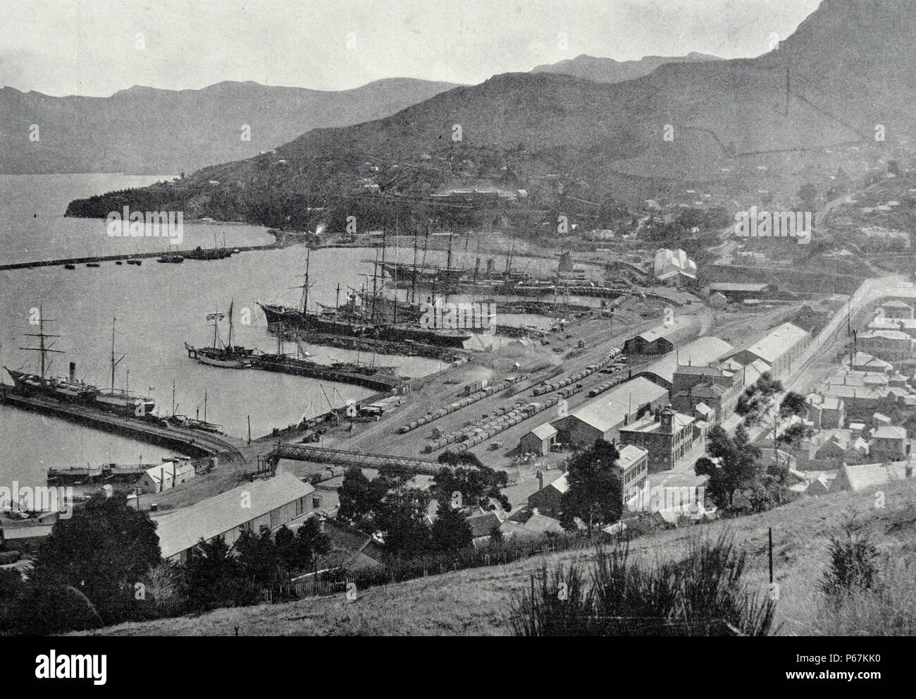 Photograph of Lyttelton Harbour, one of two major inlets in Banks Peninsula, on the coast of Canterbury, New Zealand. Dated 1900 - Stock Image