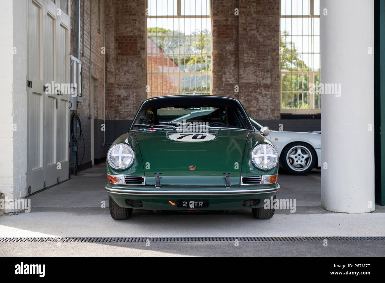 Porsche sports car in garage at Bicester heritage centre. Bicester, Oxfordshire, England Stock Photo