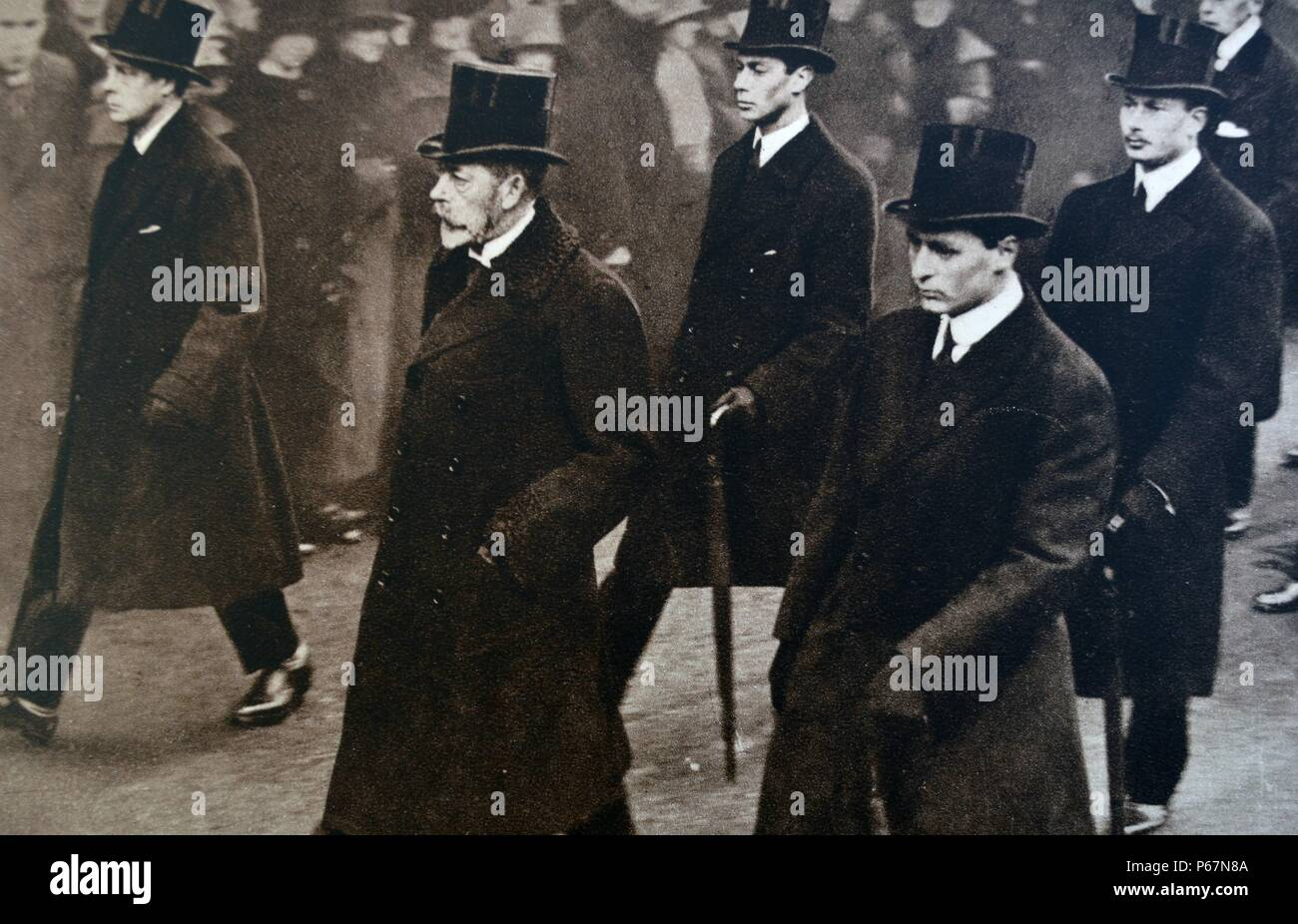 Queen Alexandra (mother of George V) funeral. The image shows George V between the Prince of Wales (later King Edward VIII) and Crown Prince Olaf of Norway. Behind them walk the Duke of York (later King George VI) and Prince Henry (the Duke of Gloucester). - Stock Image