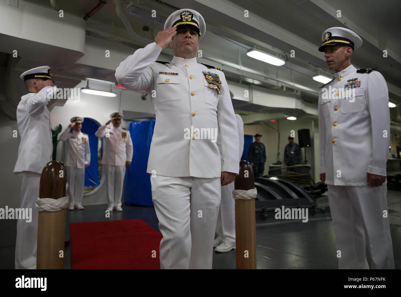NEWPORT NEWS, Va. (May 13, 2016) -- Lt. Cmdr. Michael Stone, assigned to Pre-Commissioning Unit Gerald R. Ford (CVN 78), is rung aboard during his retirement ceremony in the ship's forecastle. Ford is the first of a new class of aircraft carriers currently under construction by Huntington Ingalls Industries Newport News Shipbuilding. (U.S. Navy photo by Mass Communication Specialist Seaman Apprentice Connor Loessin/Released) - Stock Image