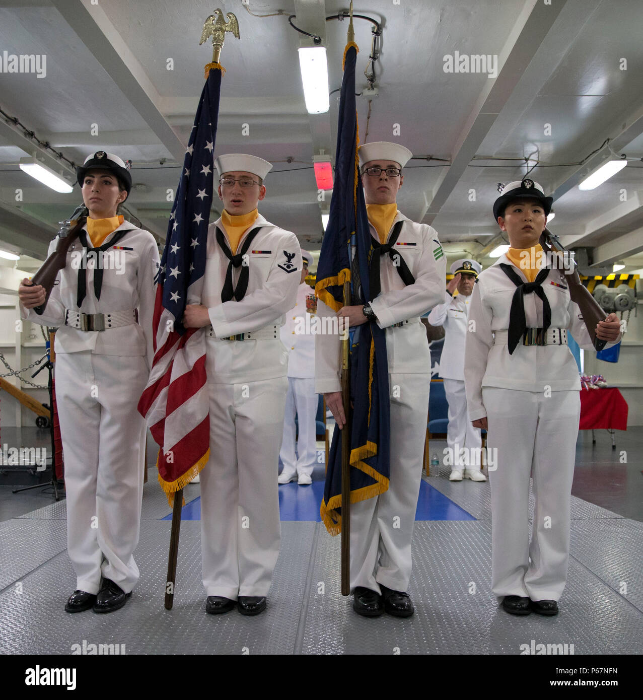 NEWPORT NEWS, Va. (May 13, 2016) --  Pre-Commissioning Unit Gerald R. Ford's (CVN 78) color guard parades the colors during a retirement ceremony in the ship's forecastle. Ford is the first of a new class of aircraft carriers currently under construction by Huntington Ingalls Industries Newport News Shipbuilding. (U.S. Navy photo by Mass Communication Specialist Seaman Apprentice Connor Loessin/Released) - Stock Image