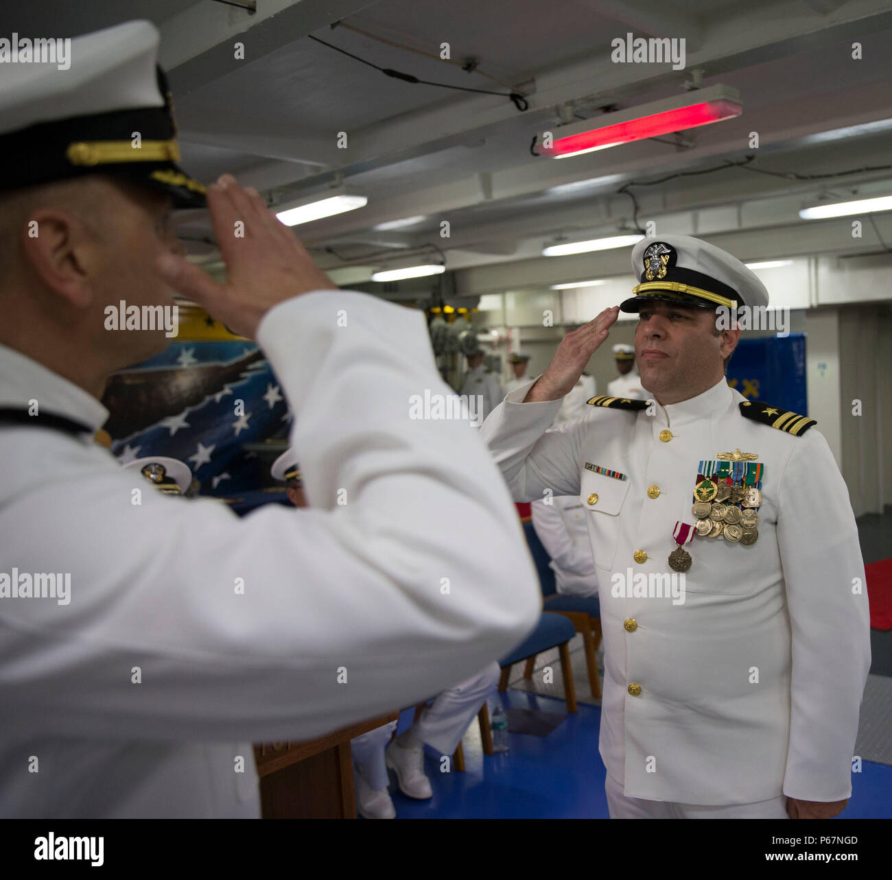 NEWPORT NEWS, Va. (May 13, 2016) --Cmdr. Allan Feenstra, chief engineer, Pre-Commissioning Unit Gerald R. Ford (CVN 78) relieves Lt. Cmdr. Michael Stone of duty during a retirement ceremony in the ship's forecastle. Ford is the first of a new class of aircraft carriers currently under construction by Huntington Ingalls Industries Newport News Shipbuilding.  (U.S. Navy photo by Mass Communication Specialist Seaman Apprentice Connor Loessin/Released) - Stock Image