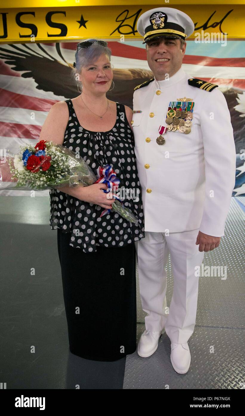 NEWPORT NEWS, Va. (May 13, 2016) --Lt. Cmdr. Michael Stone, assigned to Pre-Commissioning Unit Gerald R. Ford (CVN 78), poses with his wife, Gretchen L. Stone, following his retirement ceremony in the ship's forecastle. Ford is the first of a new class of aircraft carriers currently under construction by Huntington Ingalls Industries Newport News Shipbuilding.  (U.S. Navy photo by Mass Communication Specialist Seaman Apprentice Connor Loessin/Released) - Stock Image