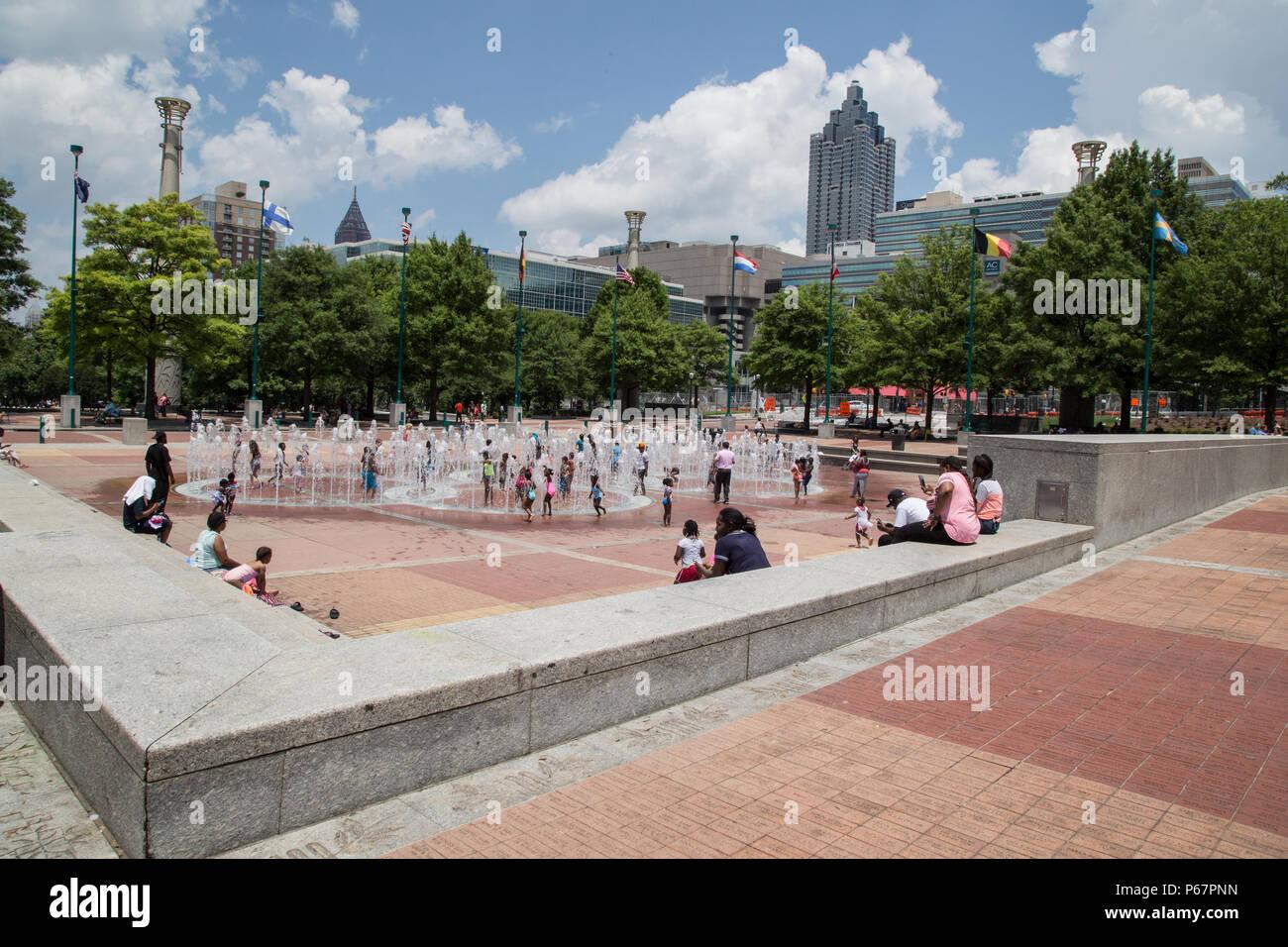 children enjoying the fountain in Centennial Park, Atlanta - Stock Image