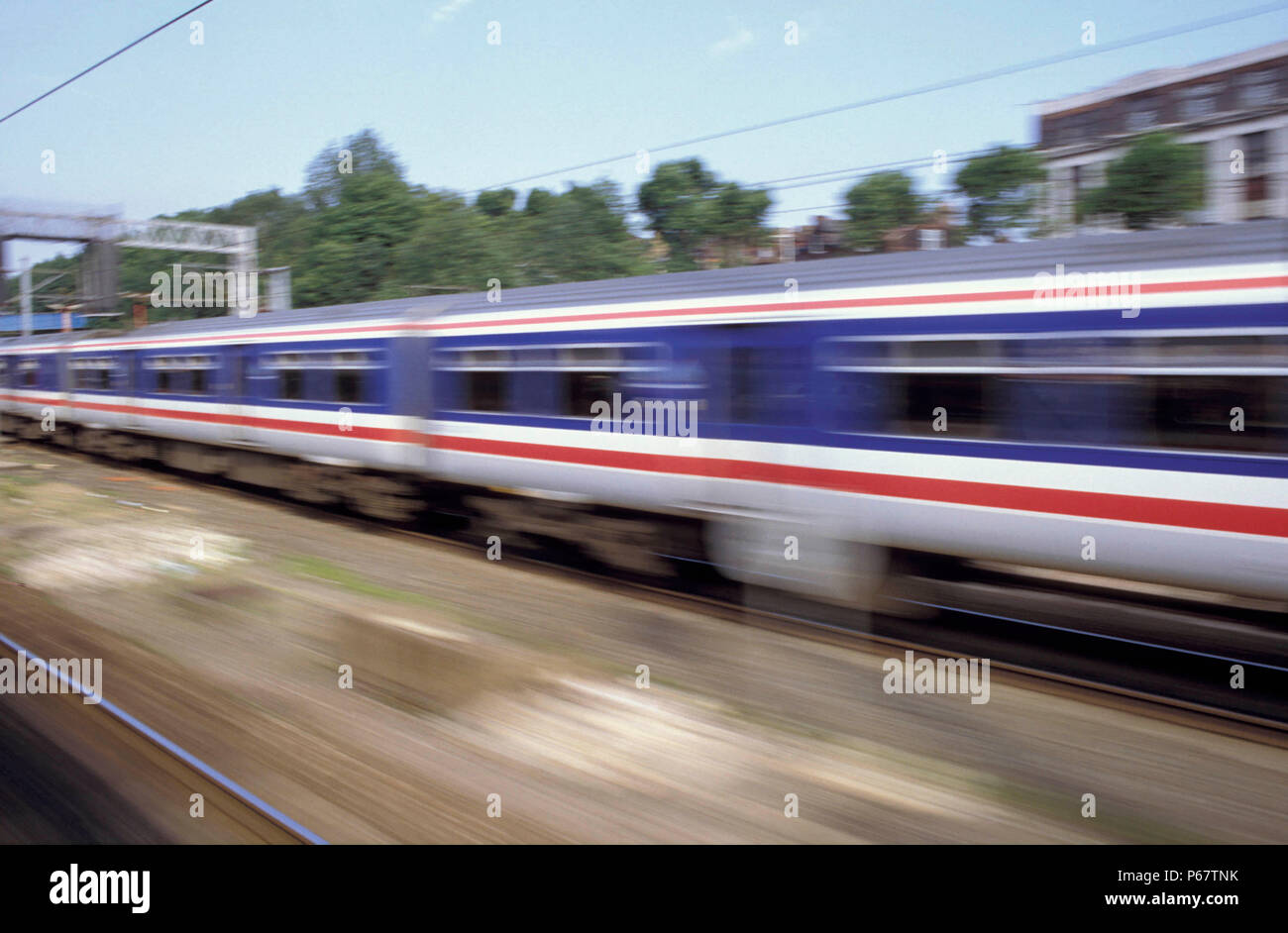 Speeding train photographed from another train. C1993 - Stock Image