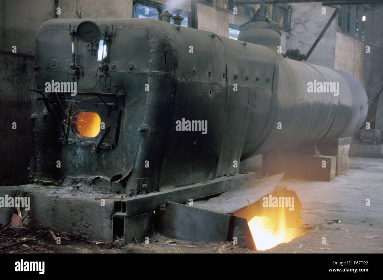 Stationary Boiler at AE Saoud Sawmill Ghana on Thursday 20 June 1985 with the boiler of a withdrawn Vulcan Foundry 4-8-2 of 1938. - Stock Image