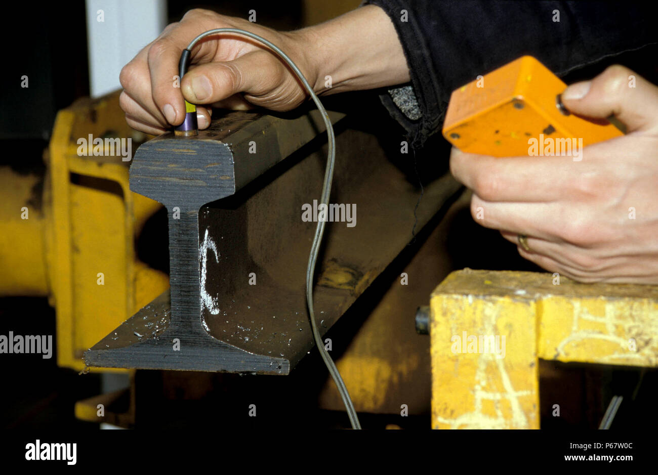 Testing newly rolled rail for conductivity. C1994. - Stock Image