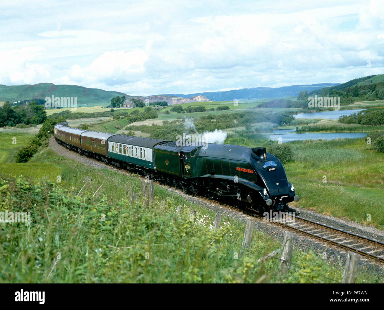 The Bon Accord. No.60009 Union Of South Africa skirts Lindores Loch near Newburgh en route to Perth to Edinburgh. 05.07.1986. - Stock Image