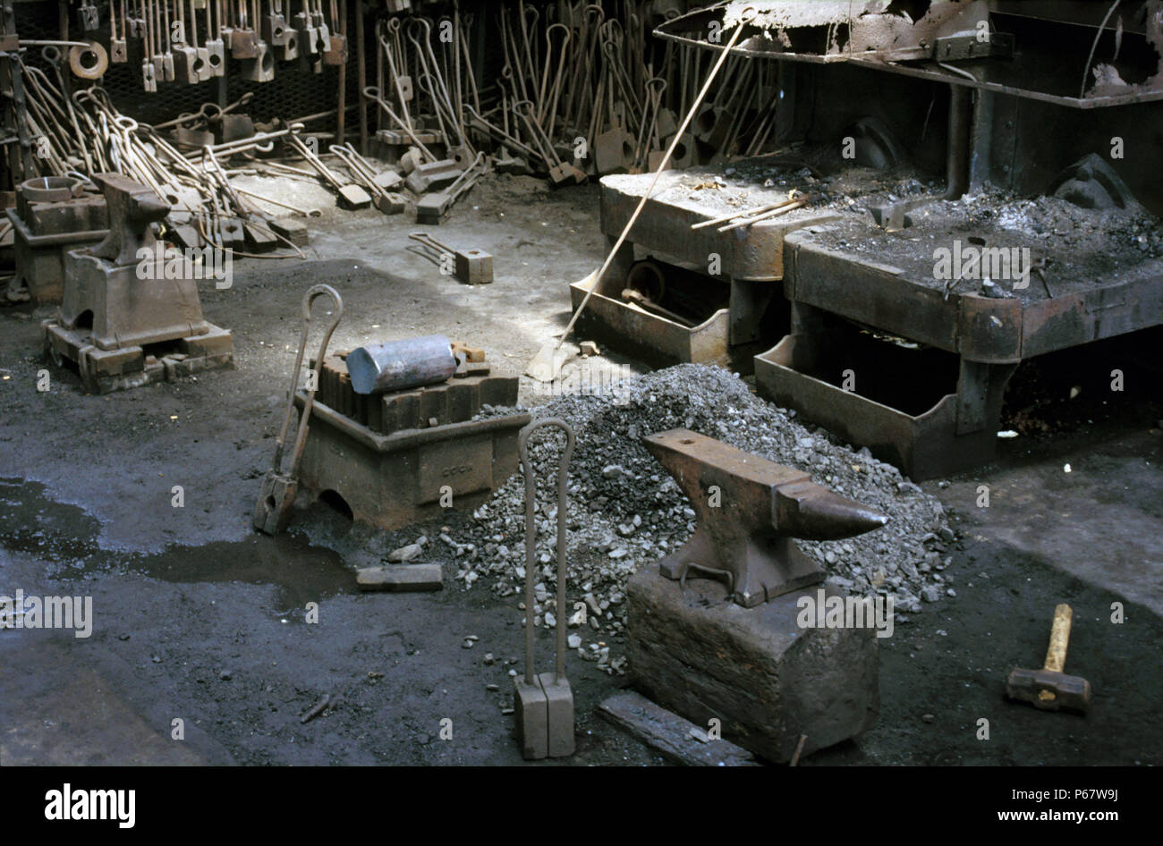 The Forge at Location Works Ghana at the end of the steam age. Anvils from Brooks of Lye in England's Black Country June 1985. - Stock Image