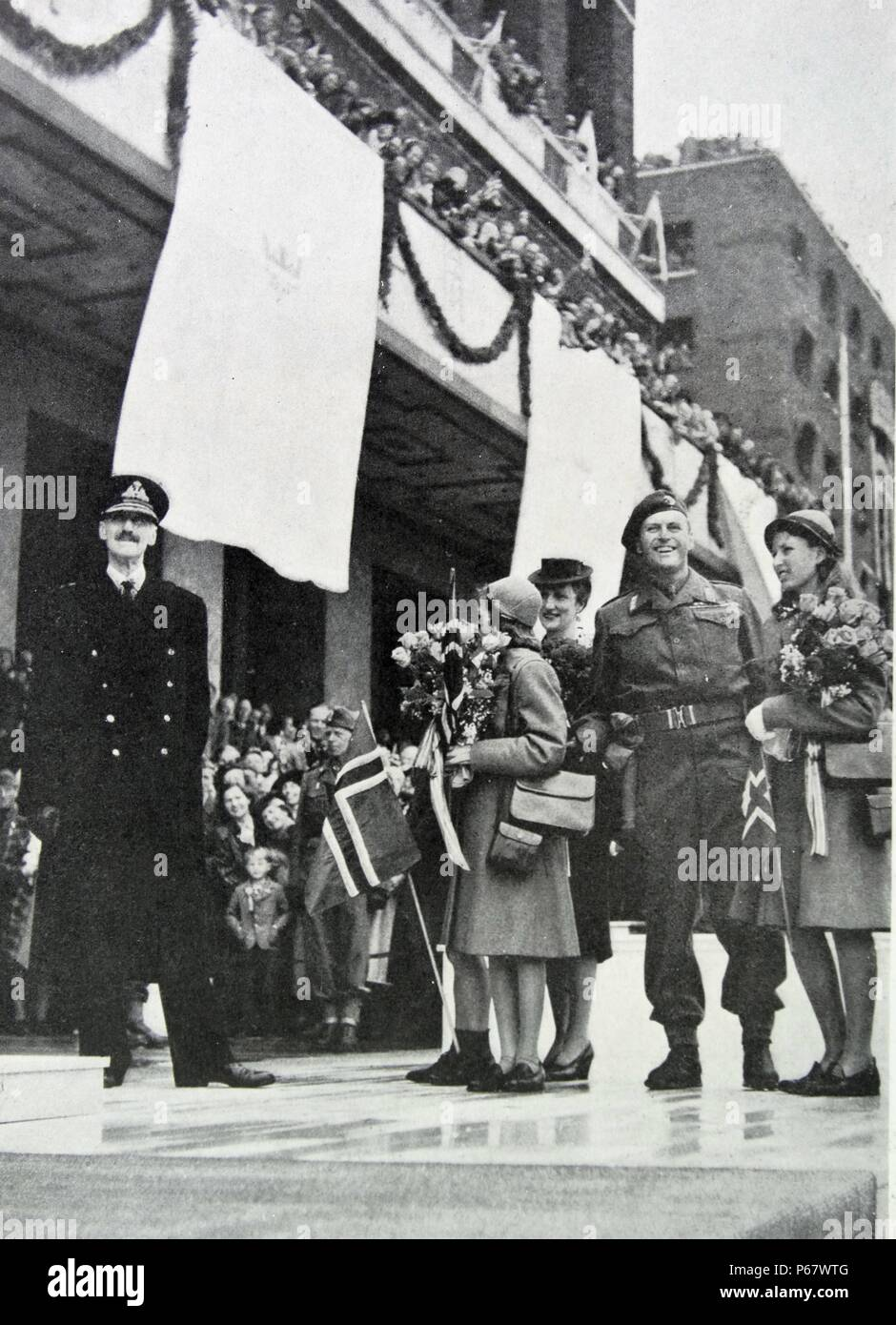 King Haakon, Crown Princess Martha, Prince Olav, and Prince Harald of Norway return home after the liberation of Norway after World War Two - Stock Image