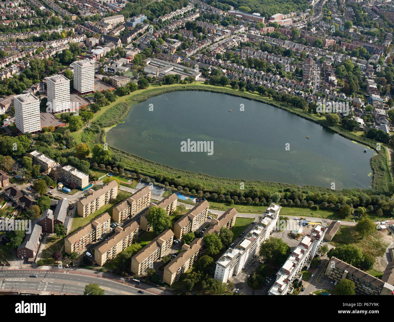 Aerial view North London reservoir and housing estates between Stratford and West Ham, London, UK. - Stock Image