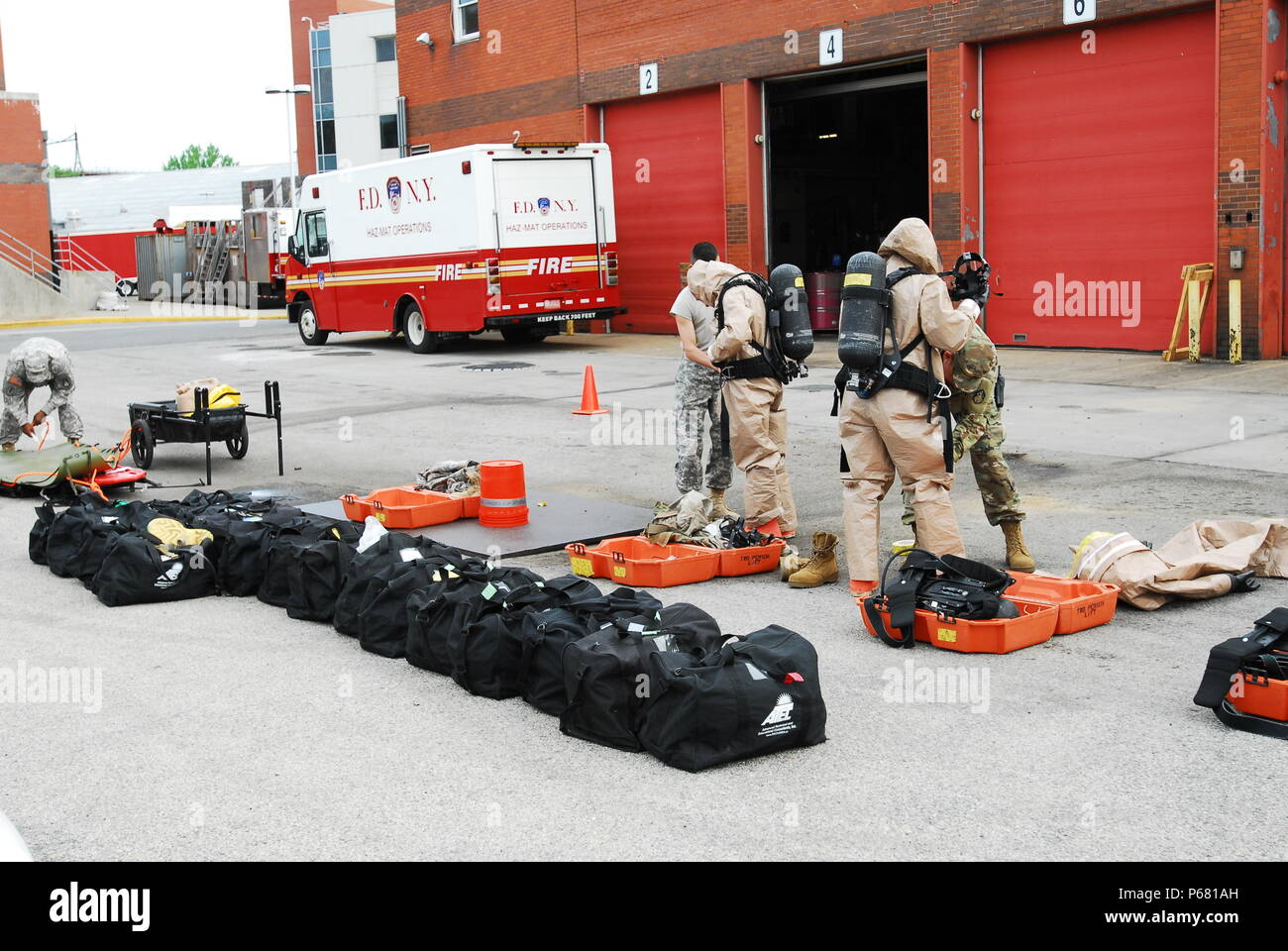 Members of the 59th Chemical, Biological, Radiological, Nuclear (CBRN) Company suit up for their Reconnaissance Sustainment Training with the New York Fire Department in New York City on May 18. As part of the training, the unit went through a series of familiarization exercises at the New York Fire Department Training Division's Facilities, which has an exact replica of a portion of the New York City subway. - Stock Image