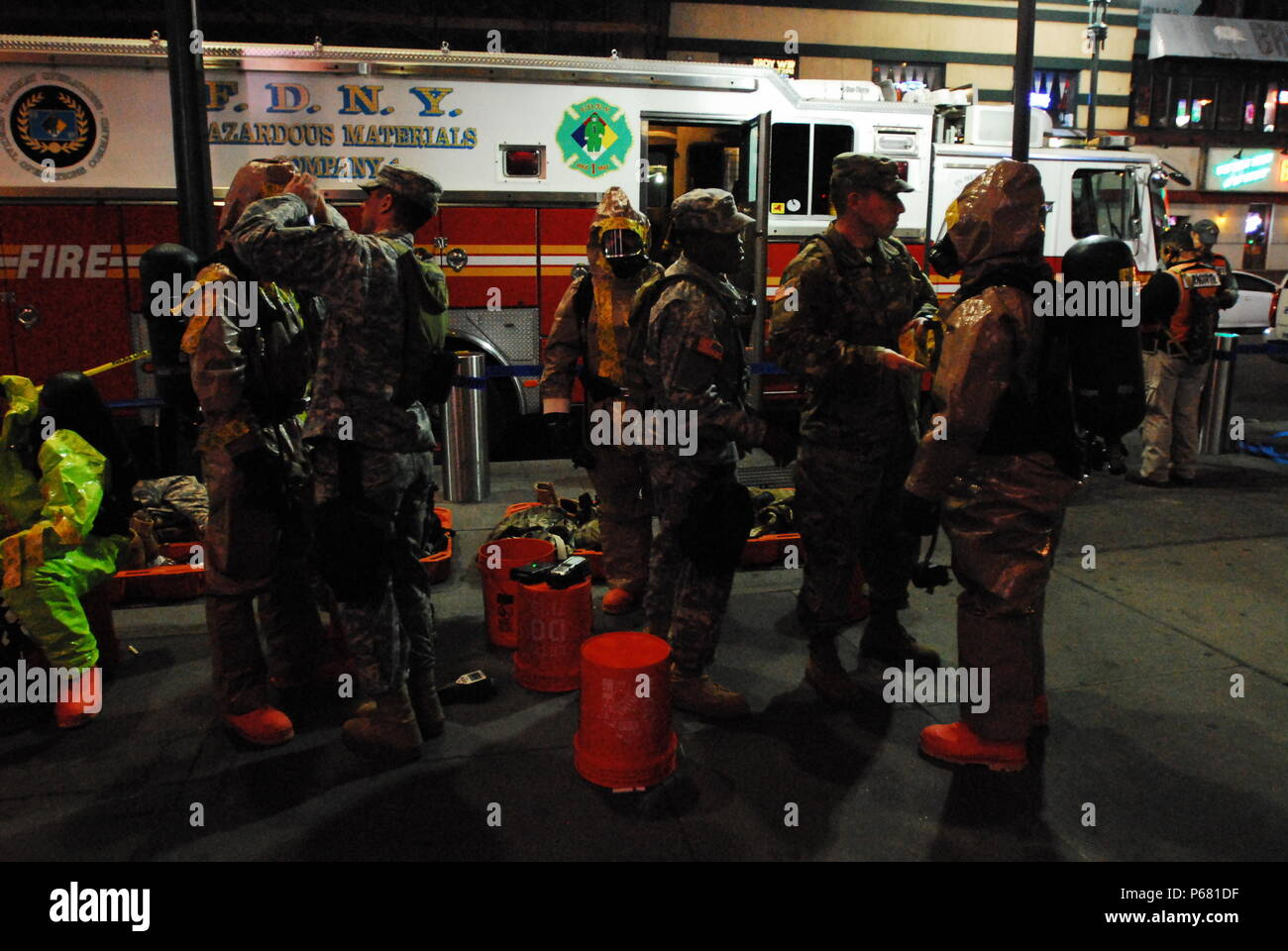 """Members of the 59th Chemical, Biological, Radiological, Nuclear (CBRN) Company suit up for their Reconnaissance Sustainment Training with the New York Fire Department at Pennsylvania Station in New York City on May 19. As part of the training, the unit collaborated with the FDNY in response to multiple """"coordinated chemical and radiological attacks"""" throughout the city including the subway system. - Stock Image"""