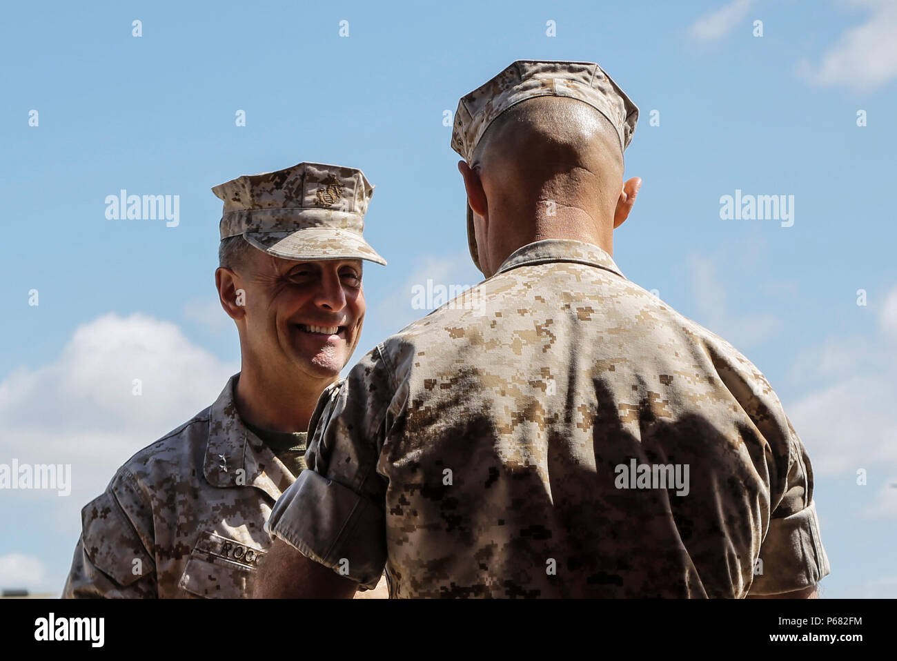 U.S. Marine Corps Maj. Gen. Michael A. Rocco Commanding Officer of  3d Marine Aircraft Wing (MAW) and Sgt. Maj. Patrick L. Kimble Sergeant Major of 3d MAW, shake hands during a relief and appointment ceremony on Marine Corps Air Station Miramar, San Diego, Calif., May 23, 2016. Sgt. Maj. Patrick L. Kimble relinquished his post as sergeant major of 3d MAW to Sgt. Maj. James K. Portfield. (U.S. Marine Corps photo by Lance Cpl. Jeremy Laboy, 3d MAW Combat Camera/Released) Stock Photo