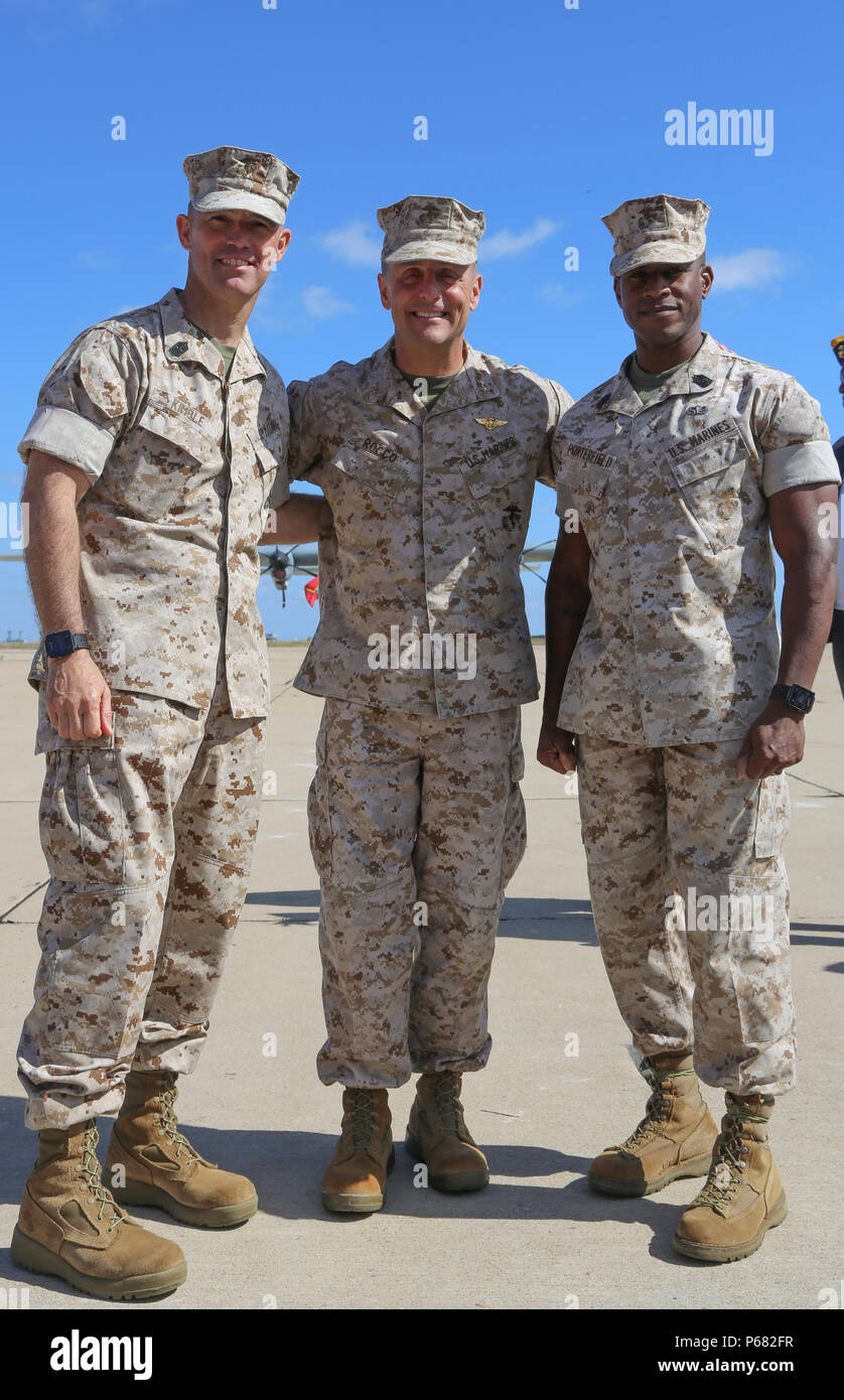 U.S. Marine Corps Sgt. Maj. Patrick L. Kimble out going Sgt. Maj. of 3d Marine Aircraft Wing (left), Maj. Gen. Michael A. Rocco Commanding Officer of 3d MAW(center) and Sgt. Maj. James K. Portfield in coming Sgt. Maj. of 3d MAW, pose for a photo during a relief and appointment ceremony on Marine Corps Air Station Miramar, San Diego, Calif., May 23, 2016. Sgt. Maj. Patrick L. Kimble relinquished his post as sergeant major of 3d MAW to Sgt. Maj. James K. Portfield. (U.S. Marine Corps photo by Lance Cpl. Jeremy Laboy, 3d MAW Combat Camera/Released) Stock Photo