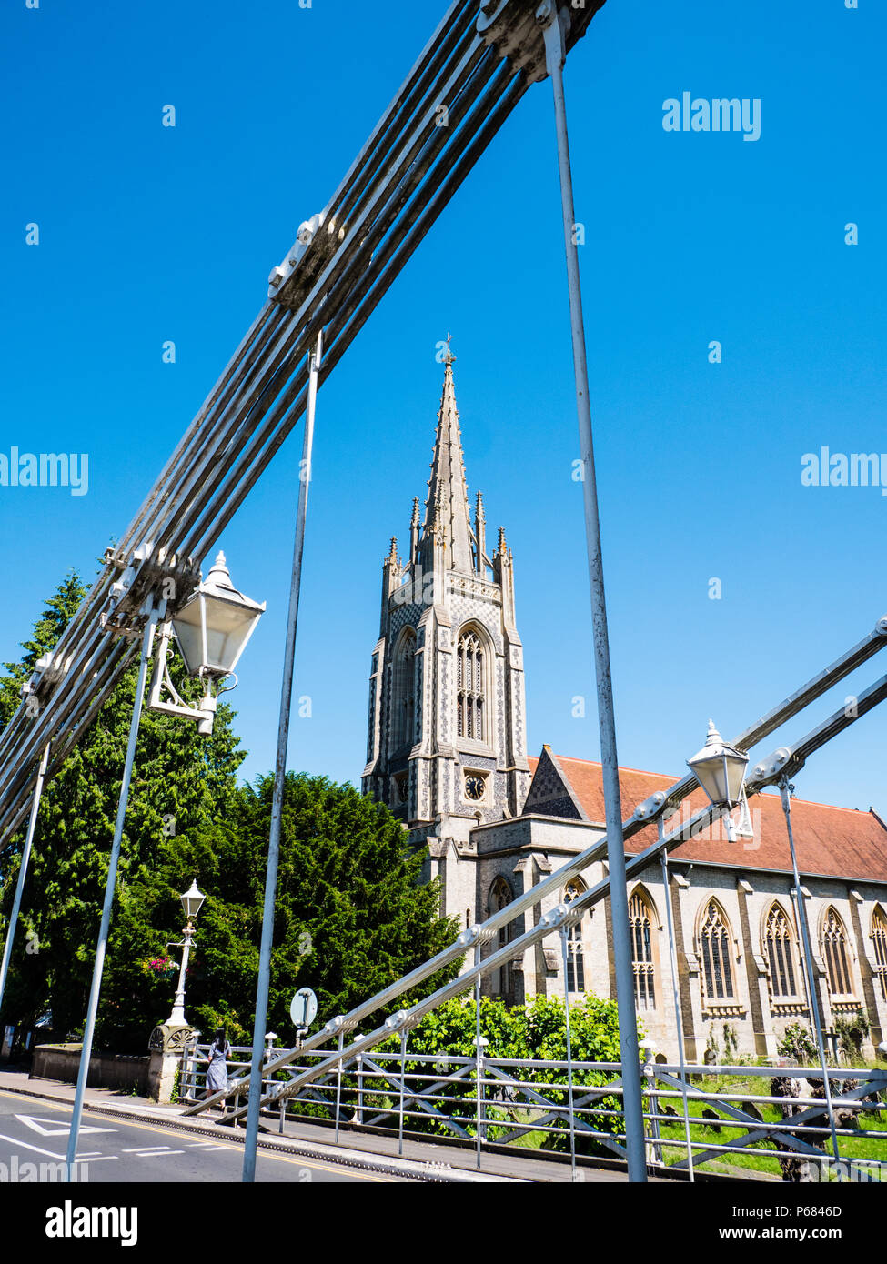 Marlow Bridge suspension bridge, Across River Thames Designed by William Tierney Clark, with All Saints Church, Marlow, Buckinghamshire, England, UK, - Stock Image