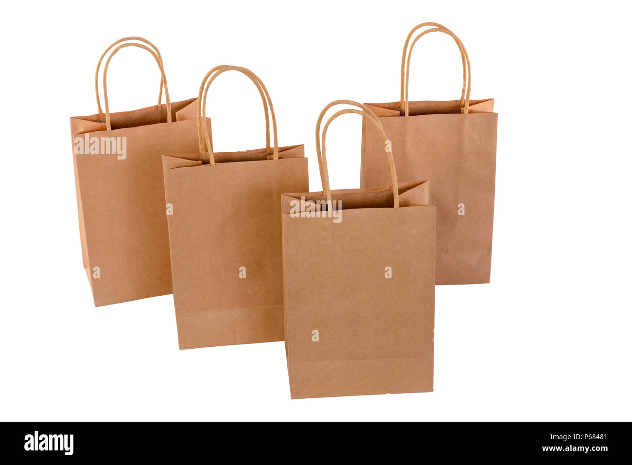 Brown paper shopping bags on white background. Empty area. - Stock Image