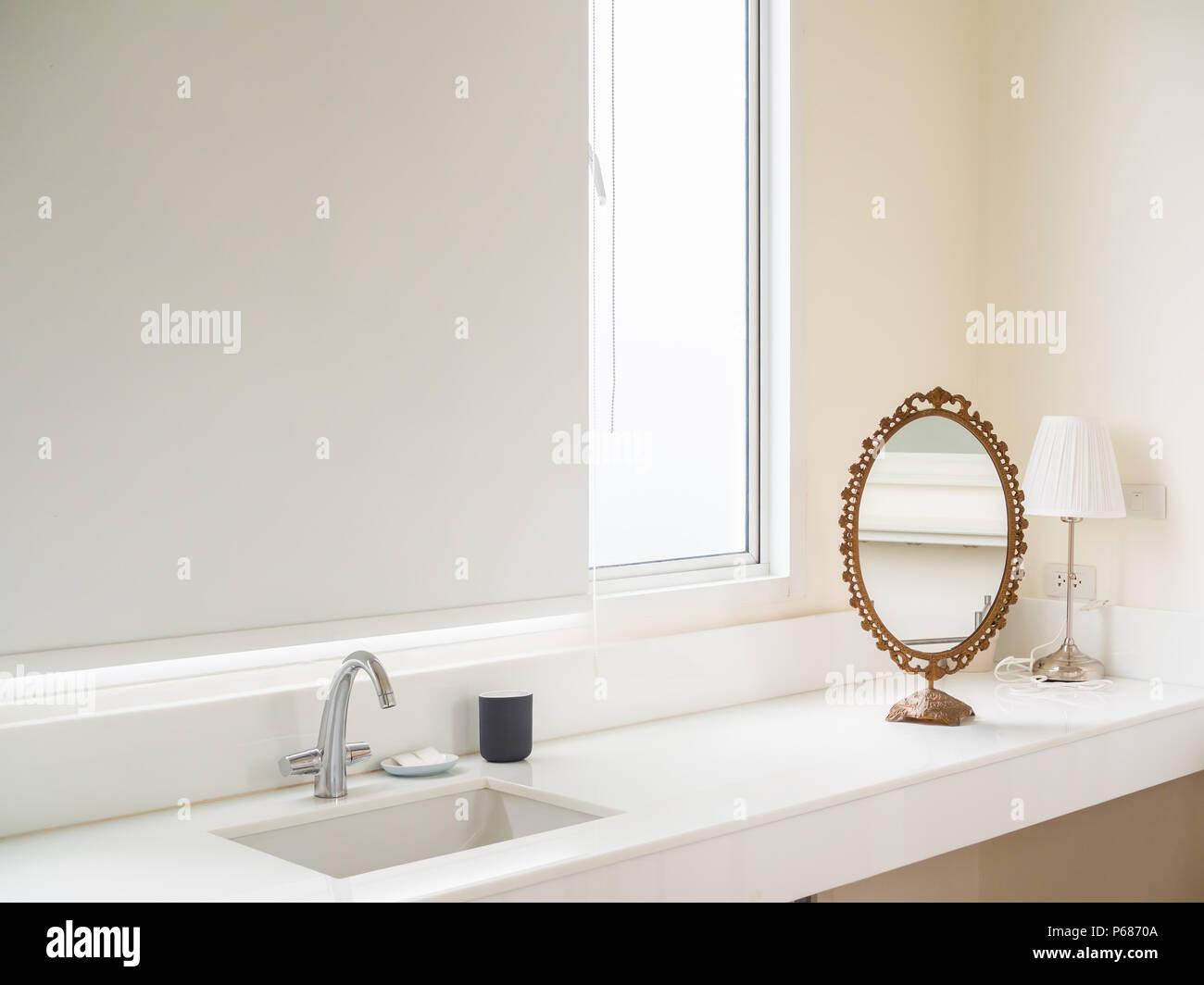 Clean White Bathroom Interior with Sink Basin Faucet, Vintage Mirror ...