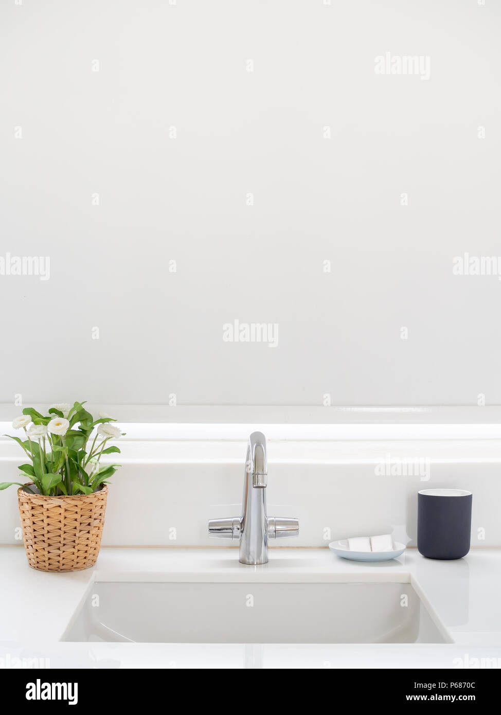 Clean White Bathroom Interior with Sink Basin Faucet, Flower in ...