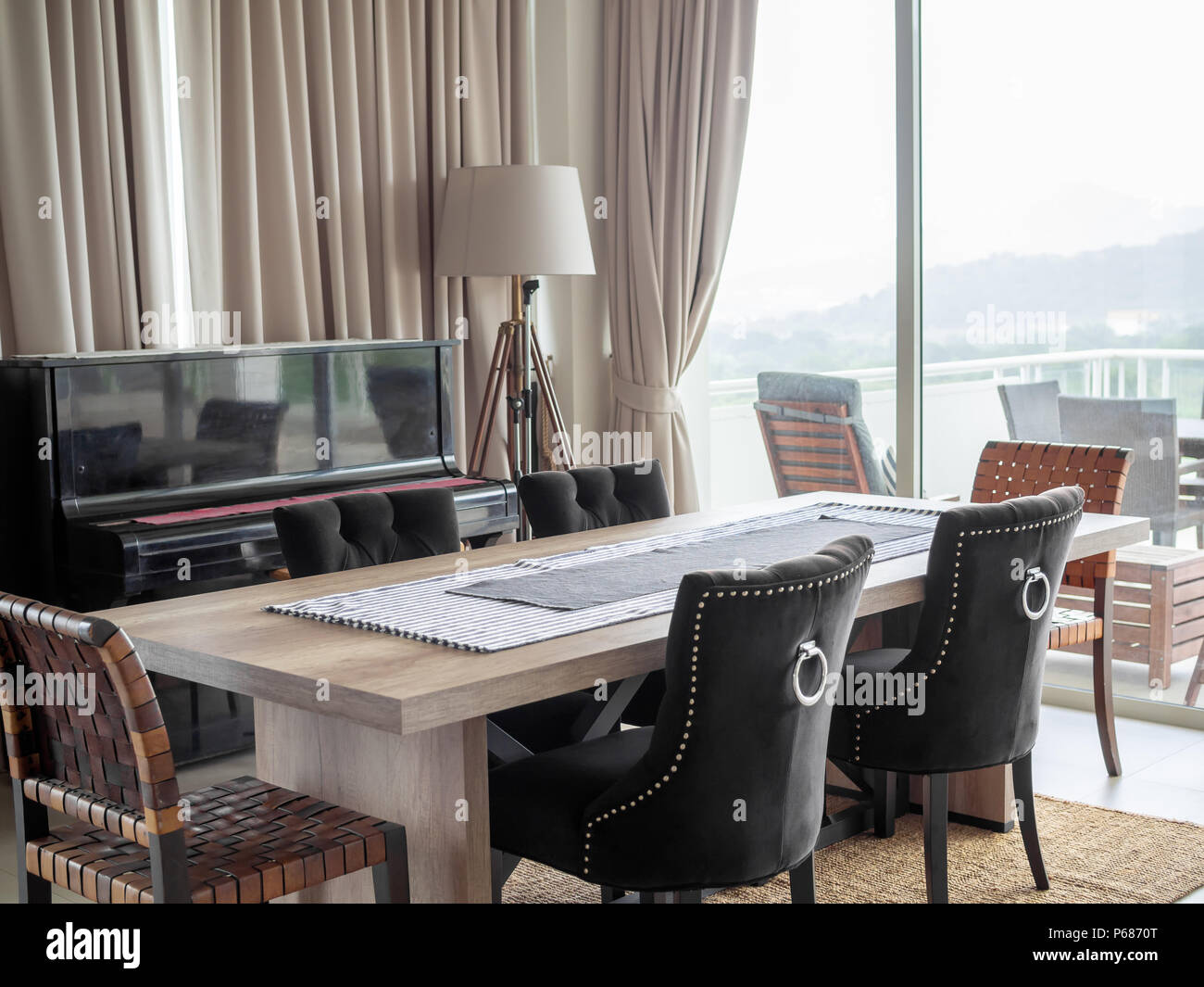 luxury chairs for living room arabic luxury modern luxury dining room interior with wooden table chairs on the carpet classic piano floor lamp and curtain near terrace