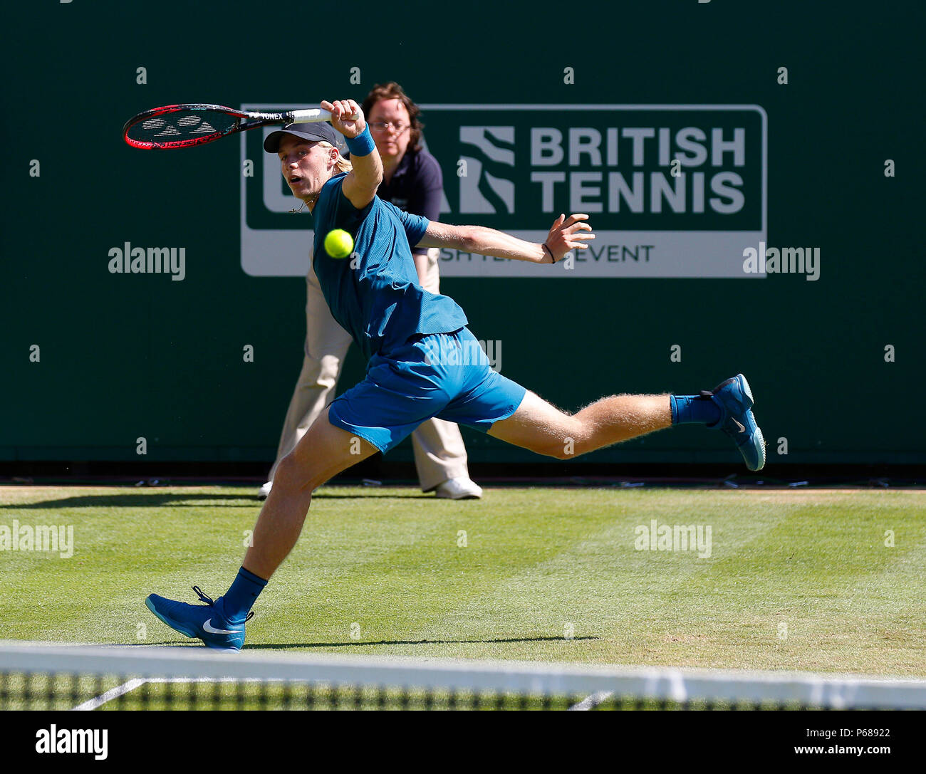 Devonshire Park, Eastbourne, UK. 28th June, 2018. Nature Valley International Tennis; Denis Shapovalov (CAN) plays a running backhand shot in his match against Mischa Zverev (GER) Credit: Action Plus Sports/Alamy Live News - Stock Image