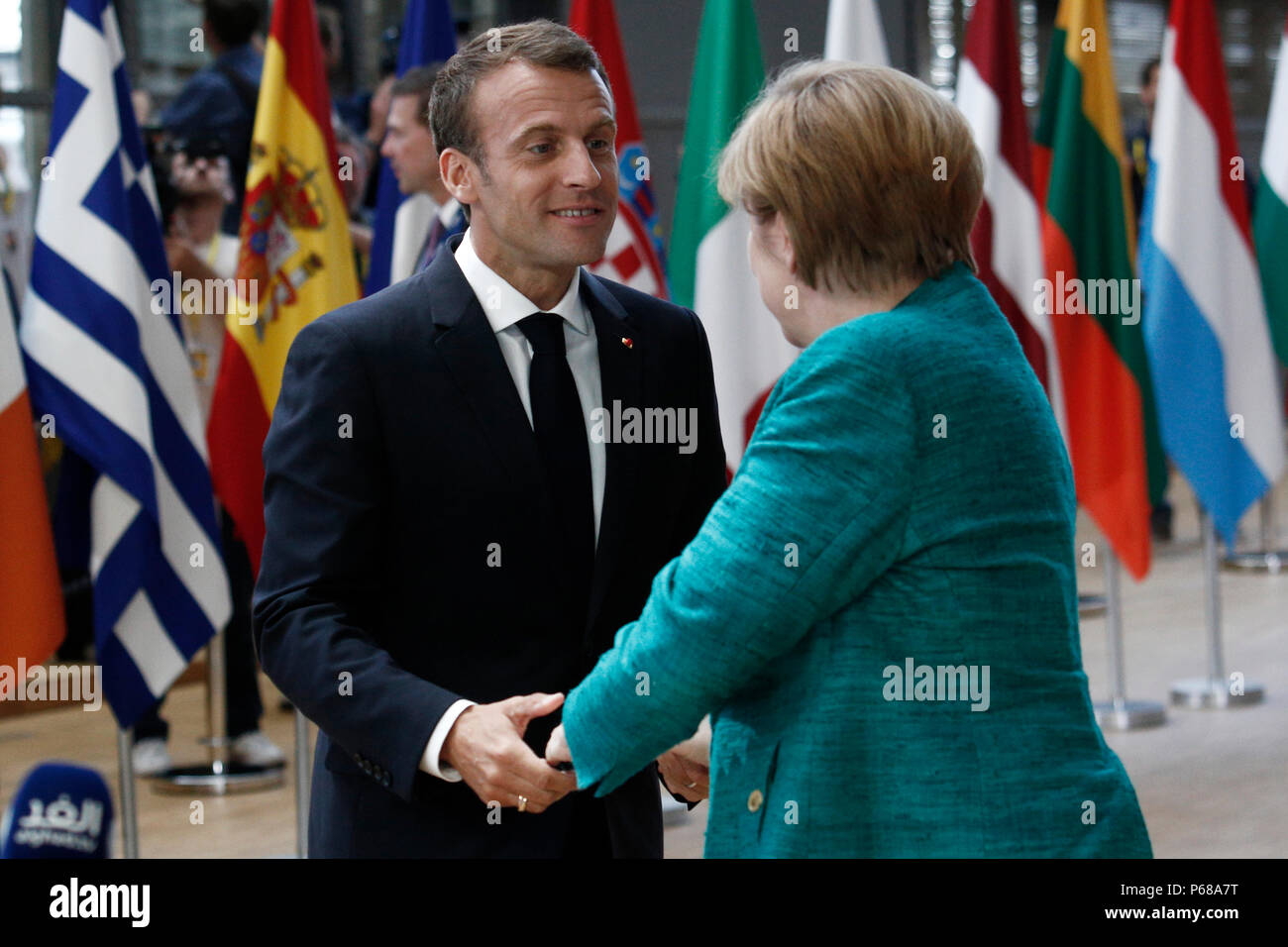 Brussels belgium on jun 28 2018rman chancellor angela merkel german chancellor angela merkel and french president emmanuel macron greet each other as they arrive at an european union leaders summit m4hsunfo