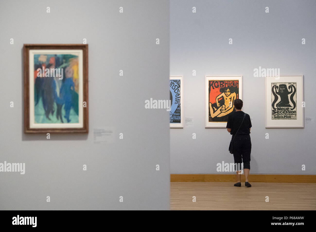 Stuttgart, Germany. 28th June, 2018. A woman attending a press conference for the exhibition 'Ernst Ludwig Kirchner. Die unbekannte Sammlung' looking at art by Ernst Ludwig Kirchner at the Staatsgalerie. Staatsgalerie is set to show art by Kirchner from 29 June to 21 October 2018. Credit: Marijan Murat/dpa/Alamy Live News - Stock Image