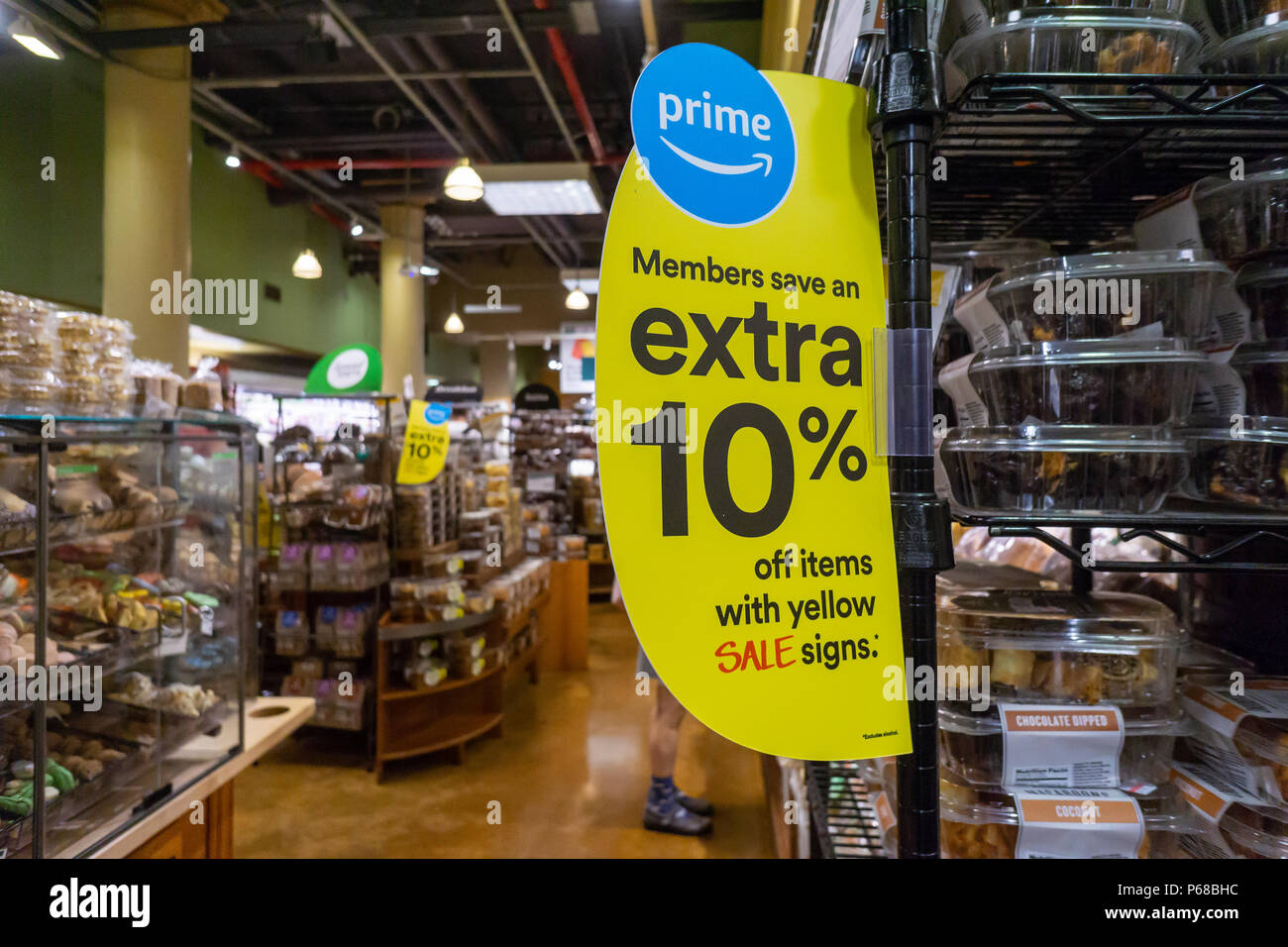 New York, USA. 28th June, 2018. The Whole Foods Market in the Chelsea neighborhood of New York advertises  Amazon's offer to Prime members of an extra 10% discount on select sale items within the store, seen on Thursday, June 28, 2018. The program rolled out nationally on Wednesday although it was available in select areas starting in May.  (© Richard B. Levine) Credit: Richard Levine/Alamy Live News - Stock Image