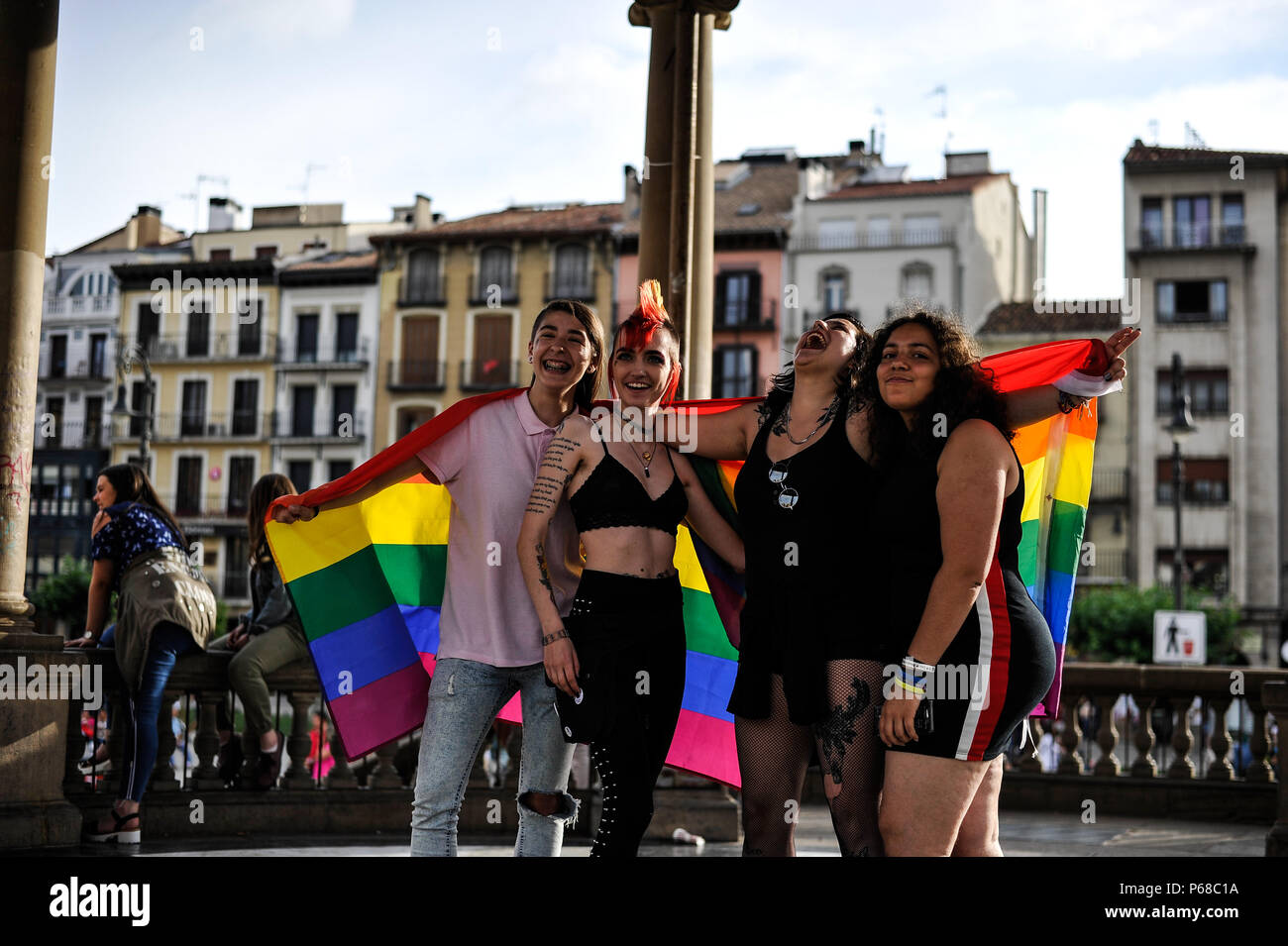 Pamplona, Spain. 28th June, 2018. Participants in the gay pride parade waves flags as thousands of people rally for LGBTQ+ rights in Pamplona, Spain on June 28, 2018 to mark the start of Pride weekend in the city. Credit: Mikel Cia Da Riva/Alamy Live News - Stock Image