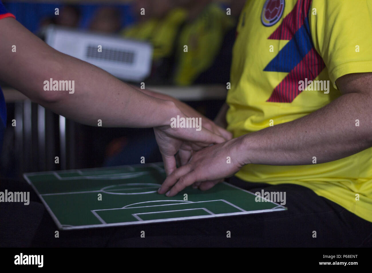 Bogota, Colombia. 20th July, 2016. Cesar narrates the game to his friend Jose through sign language the parity of Colombia against Senegal that won the Colombian team Credit: Daniel AndréS GarzóN Herazo/ZUMA Wire/Alamy Live News - Stock Image