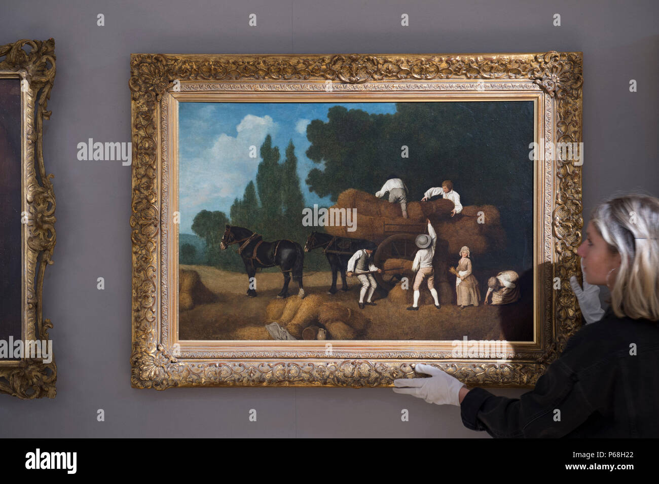 Bonhams New Bond Street, London, UK. 29 June, 2018. Harvesting, by George Stubbs (1724-1806) and estimated at £350,000-450,000 in the Old Masters sale preview. Painted in the early 1780s, the work encapsulates Stubbs lyrical realism. The sale takes place on Wednesday 4 July 2018 at 2pm. Credit: Malcolm Park/Alamy Live News. - Stock Image