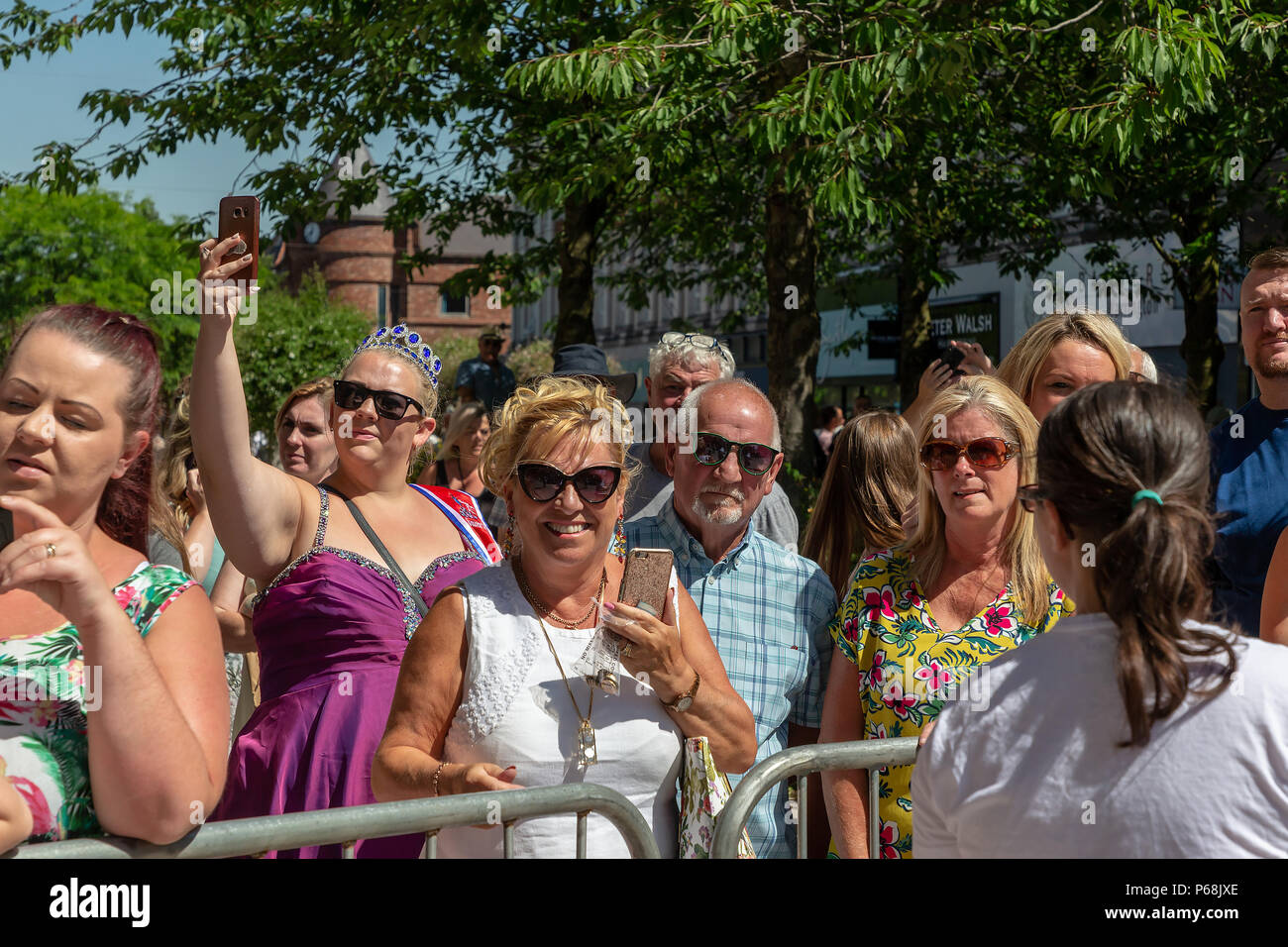 Warrington, UK. 29 June 2018 - The weather was hot and sunny for Warrington Walking Day. This annual religious event begins in front of the Town Hall and leraves through the famous golden gates with the procession following the closed streets and through the town centre Credit: John Hopkins/Alamy Live News - Stock Image