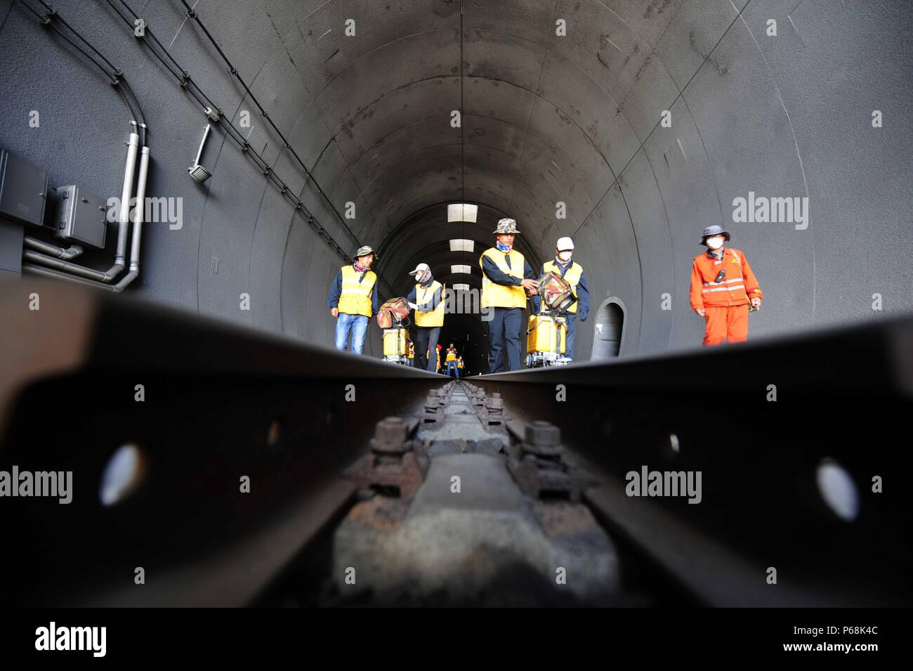 (180629) -- GOLMUD, June 29, 2018 (Xinhua) -- Maintenance workers check the tracks at the Xinguanjiao Tunnel, the world's longest plateau rail tunnel, along the Qinghai-Tibet Railway in northwest China's Qinghai Province, June 27, 2018. With a length of 32.6 kilometers, the tunnel was put into operation at the end of 2014.  (Xinhua/Hou Deqiang)(mcg) - Stock Image