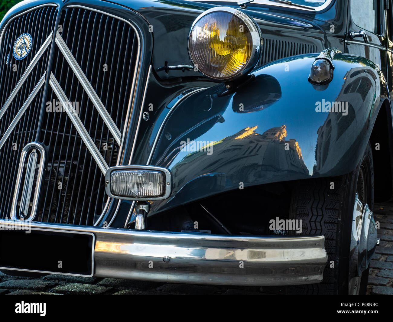 A Citroen Traction Avant sitting on a cobbled street near to Sacre Couer in the Montmatre district of Paris Stock Photo
