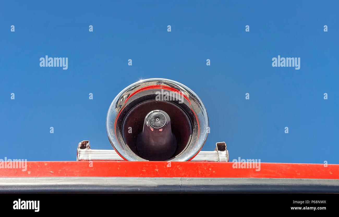 Chrome Siren on fire trucks rooftop. Stock Image. - Stock Image