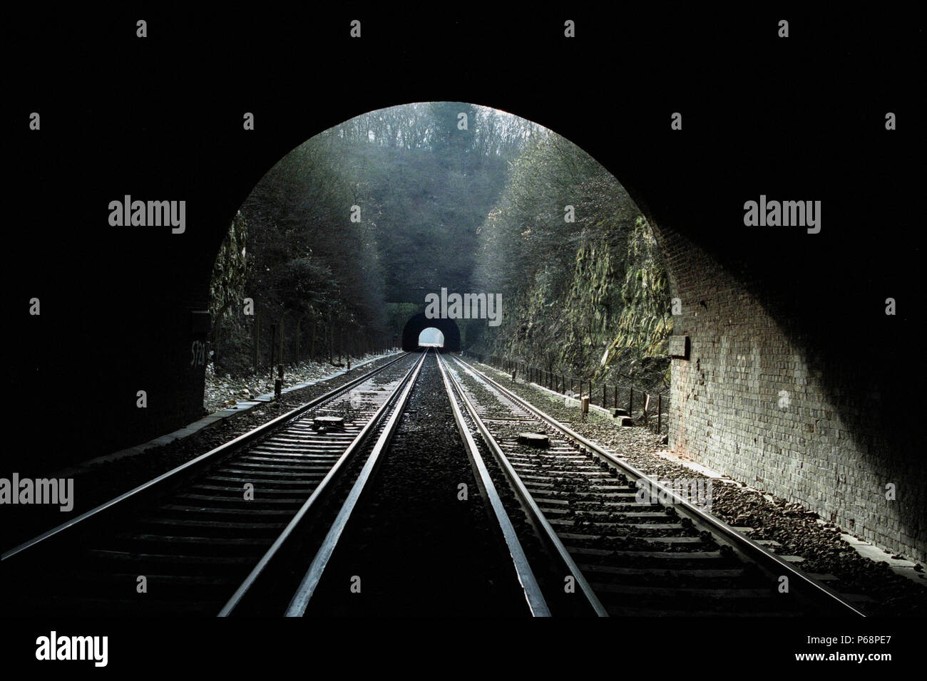 The view from inside Popham tunnel number 1 looking north towards Poham tunnel number 2. 23rd Febrauary 2003. - Stock Image