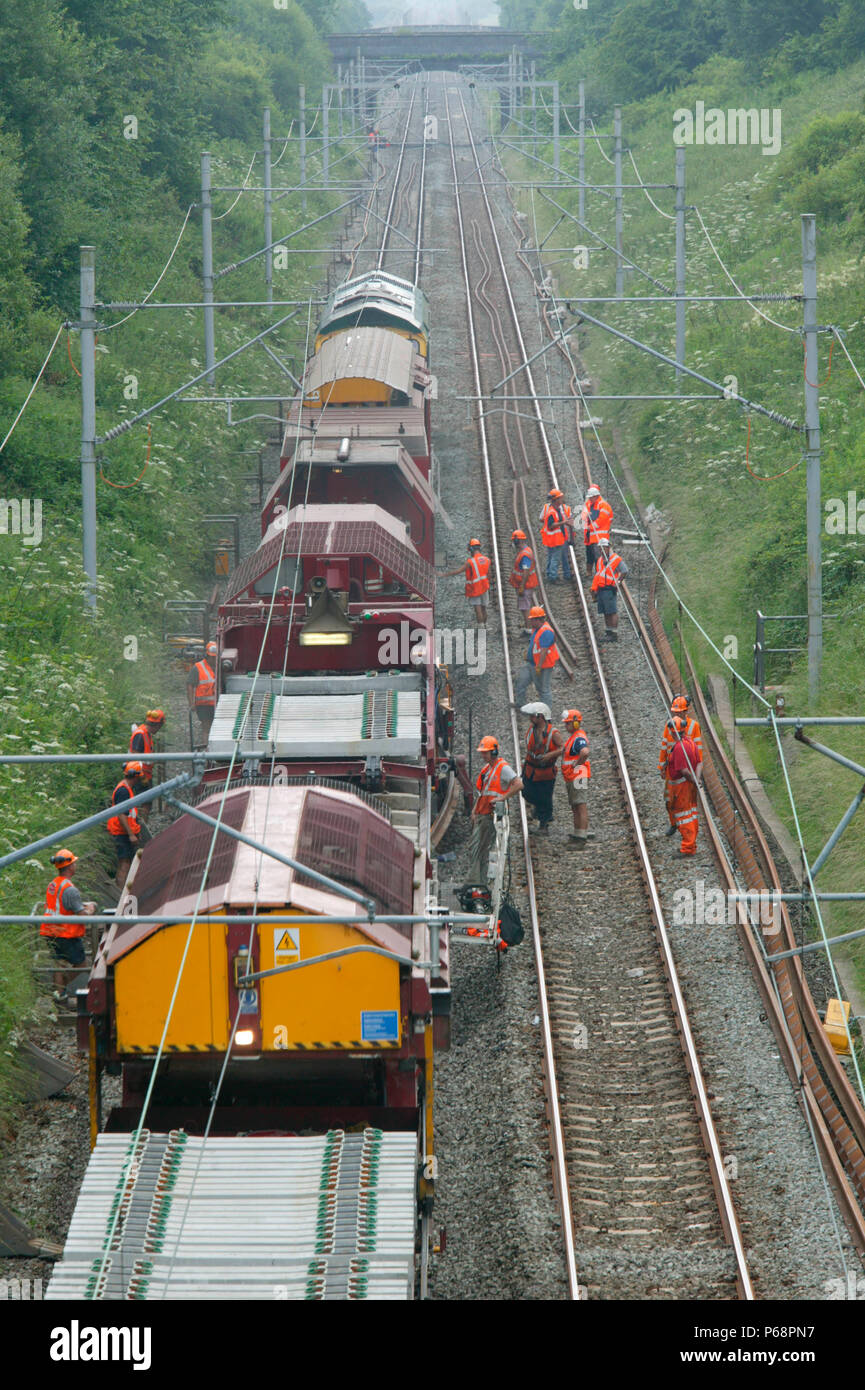 Track relaying machine (TRT) in action near Poynton as part of the West Coast Main Line upgrade. July 2003. - Stock Image