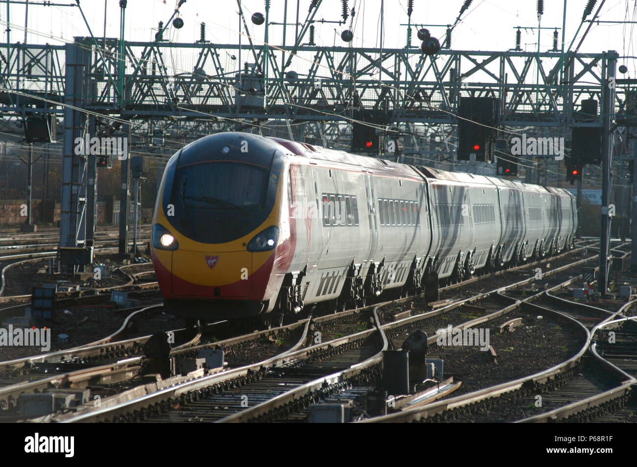 Virgin Trains Pendolino number 390.036 nears the end of its journey from Euston as it approaches Glasgow Central. November 2004. - Stock Image