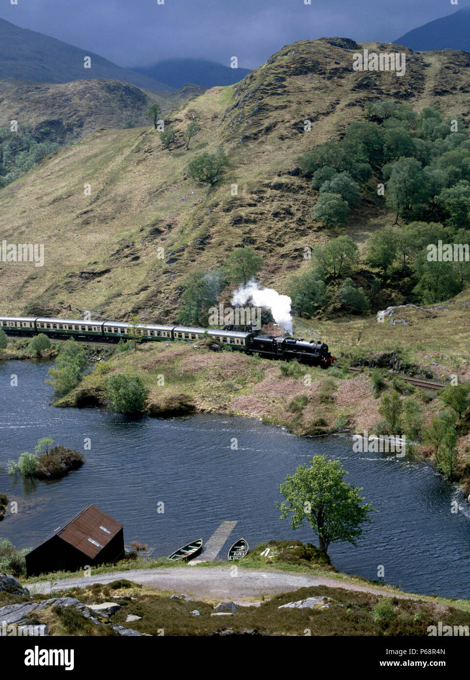 West Highlander. No.44767 George Stephenson skirts Loch Eilt en route from Fort William to Mallaig. 26.05.1985. - Stock Image