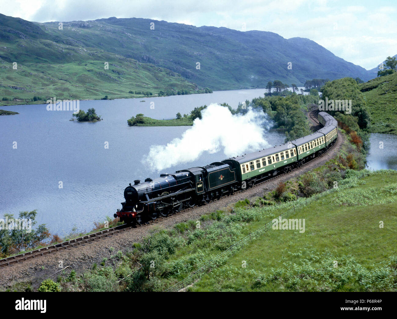 West Highlander. No.44767 George Stephenson skirts Lock Eilt with the 11:05 ex Fort William for Mallaig. 01.07.1985. - Stock Image