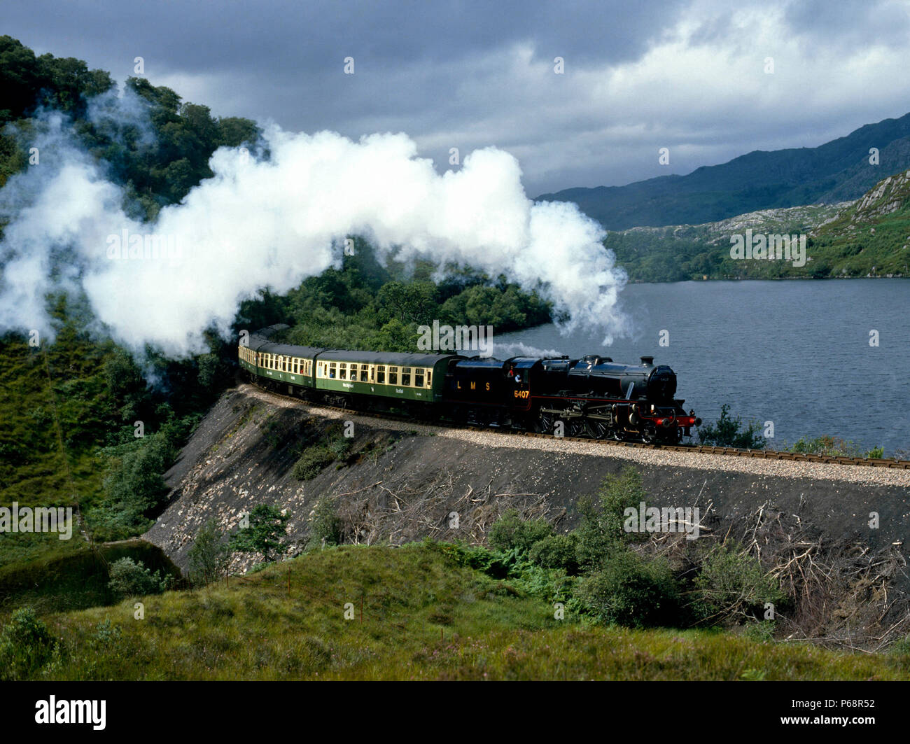 West Highlander. No.5407 Skirts Loch Dubh with the 13:35 ex Mallaig for Fort William. 06.08.1985. - Stock Image