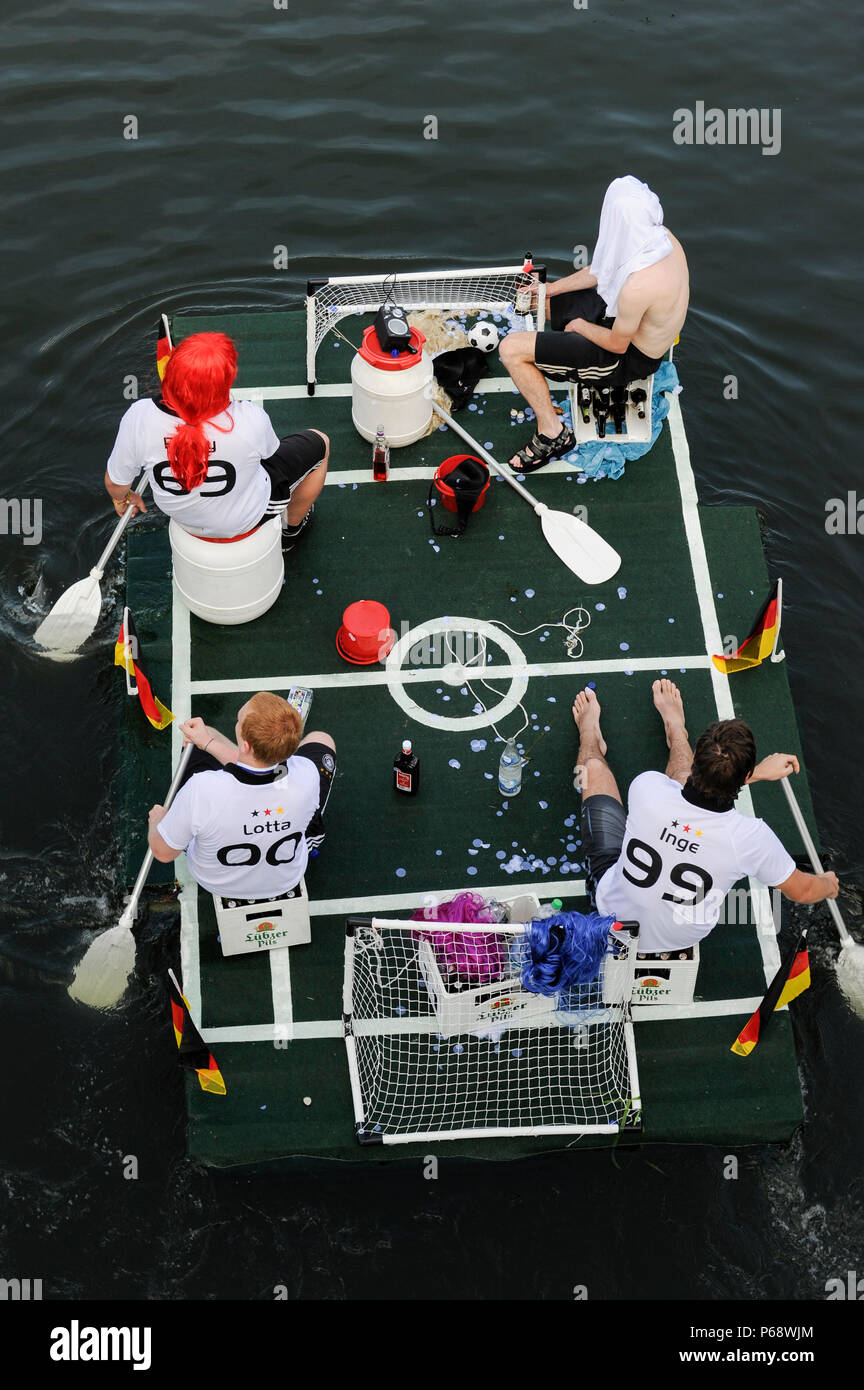 GERMANY floating soccer field with german flags, game over, going home - Stock Image