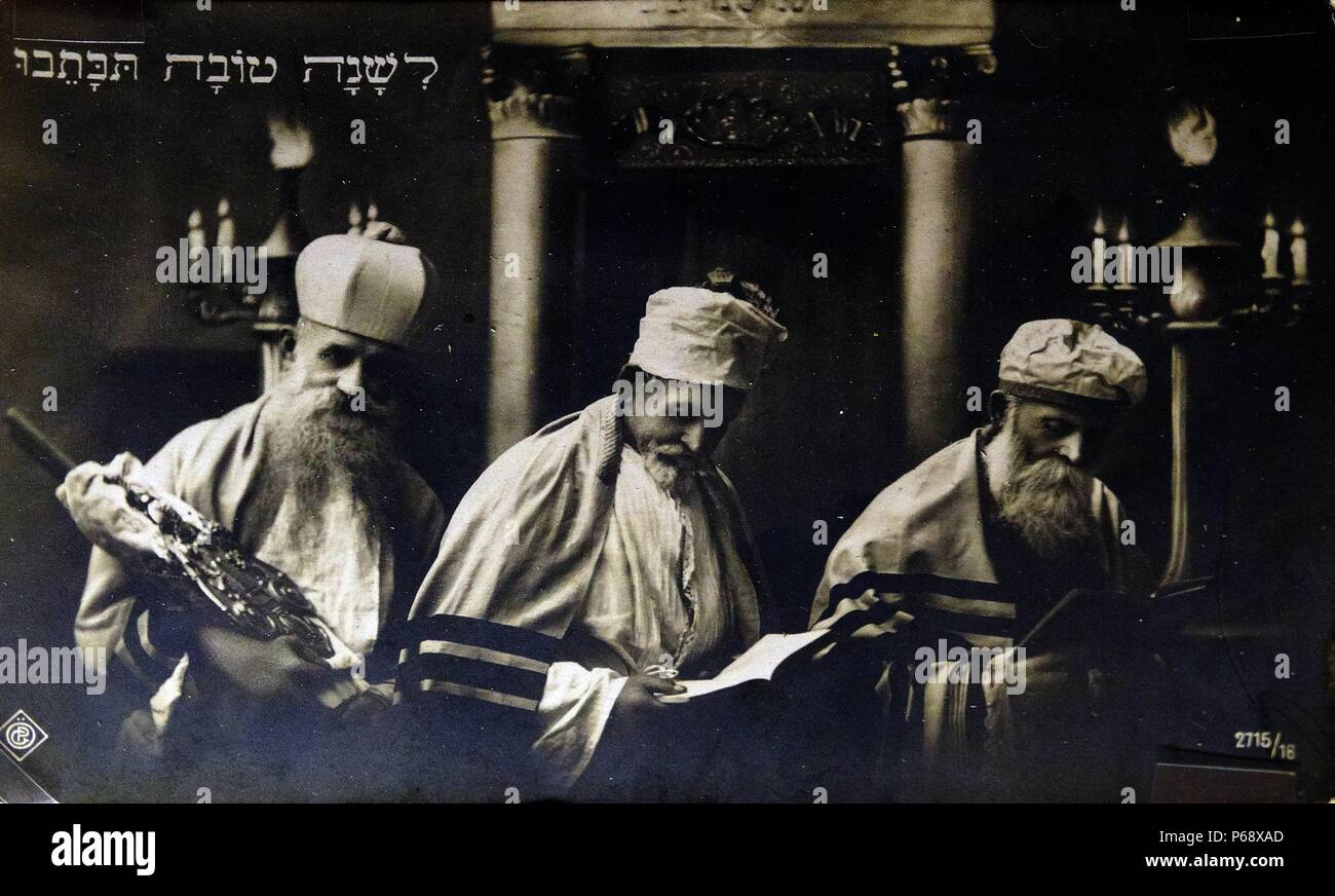 Dutch New Year Card c1910. The card shows three rabbi's in a synagogue, wearing traditional prayer shawls (tallit) c 1915. - Stock Image