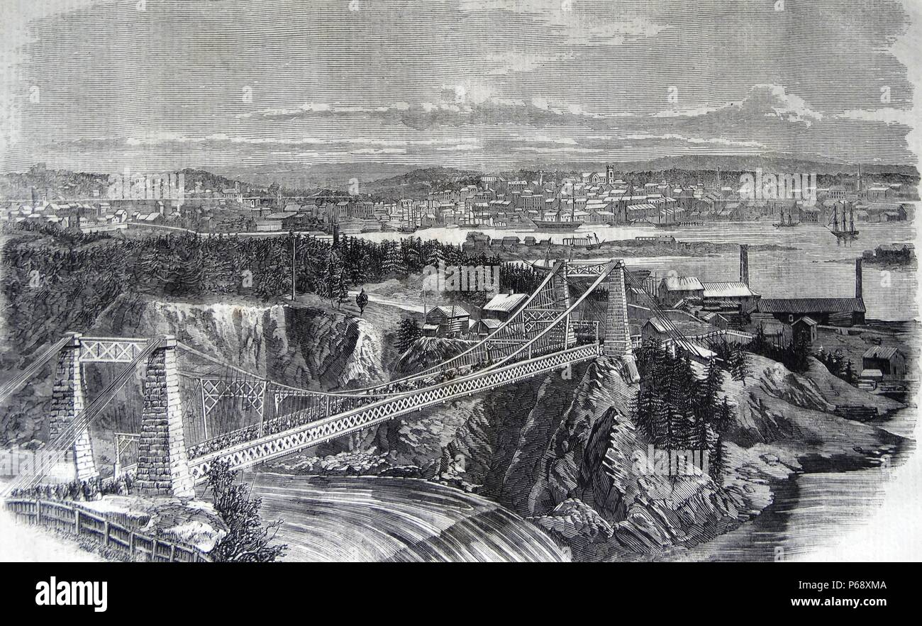 The Suspension Bridge over the River St. John; N.B.; visited by the Prince of Wales on the 7th of August; with a view of the city of St. John. From a photograph by C. Flood. - Stock Image
