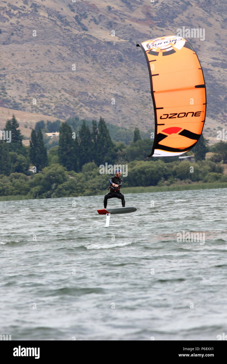 Fun on the water, this water sport of hydro kite boarding, on a lake in NZ an extream water activity for a sporting adventure holiday - Stock Image