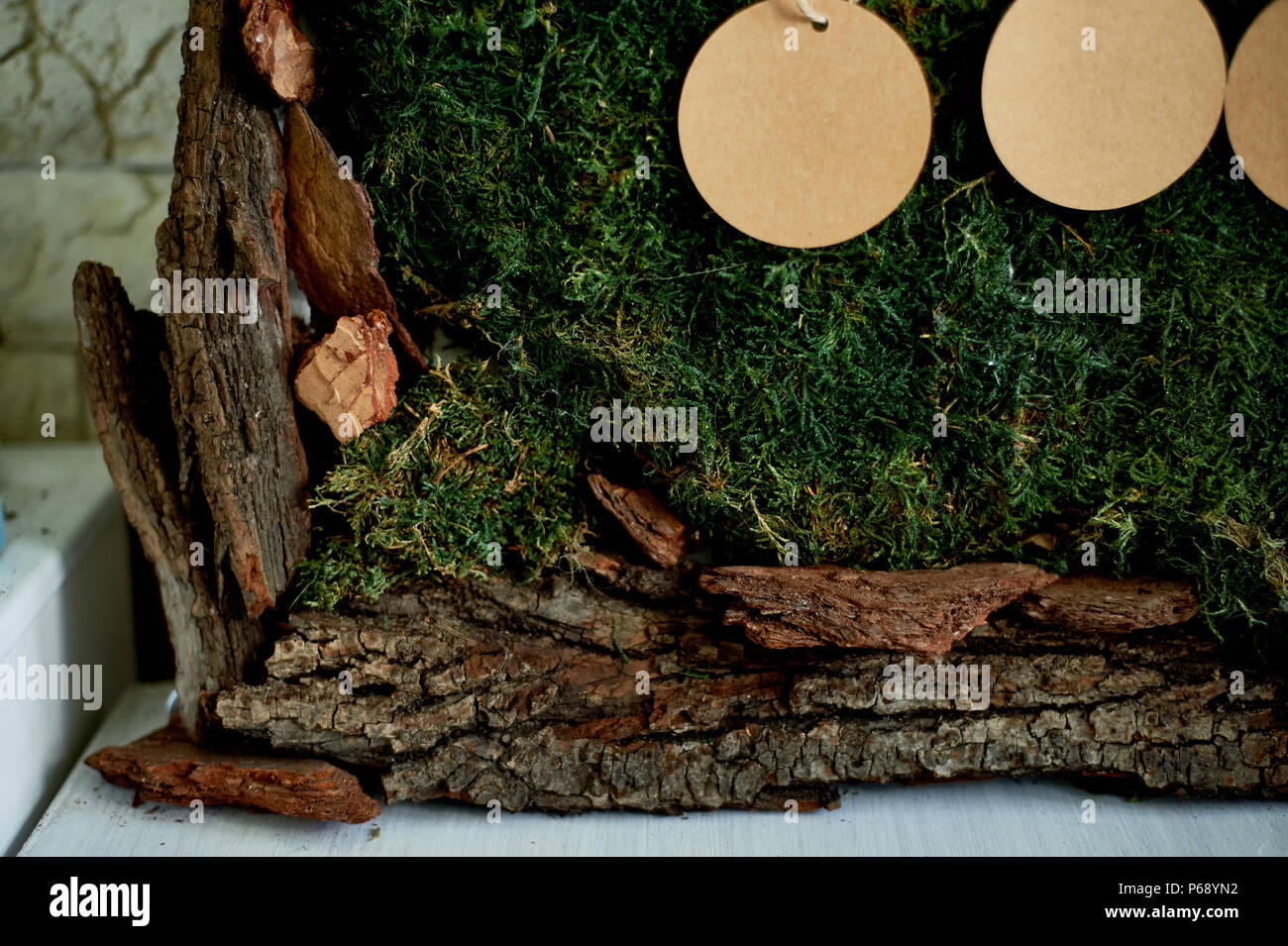 Seating plan, wedding decor in rustic style.Moss, bark, wood, crafting cards. Close details - Stock Image