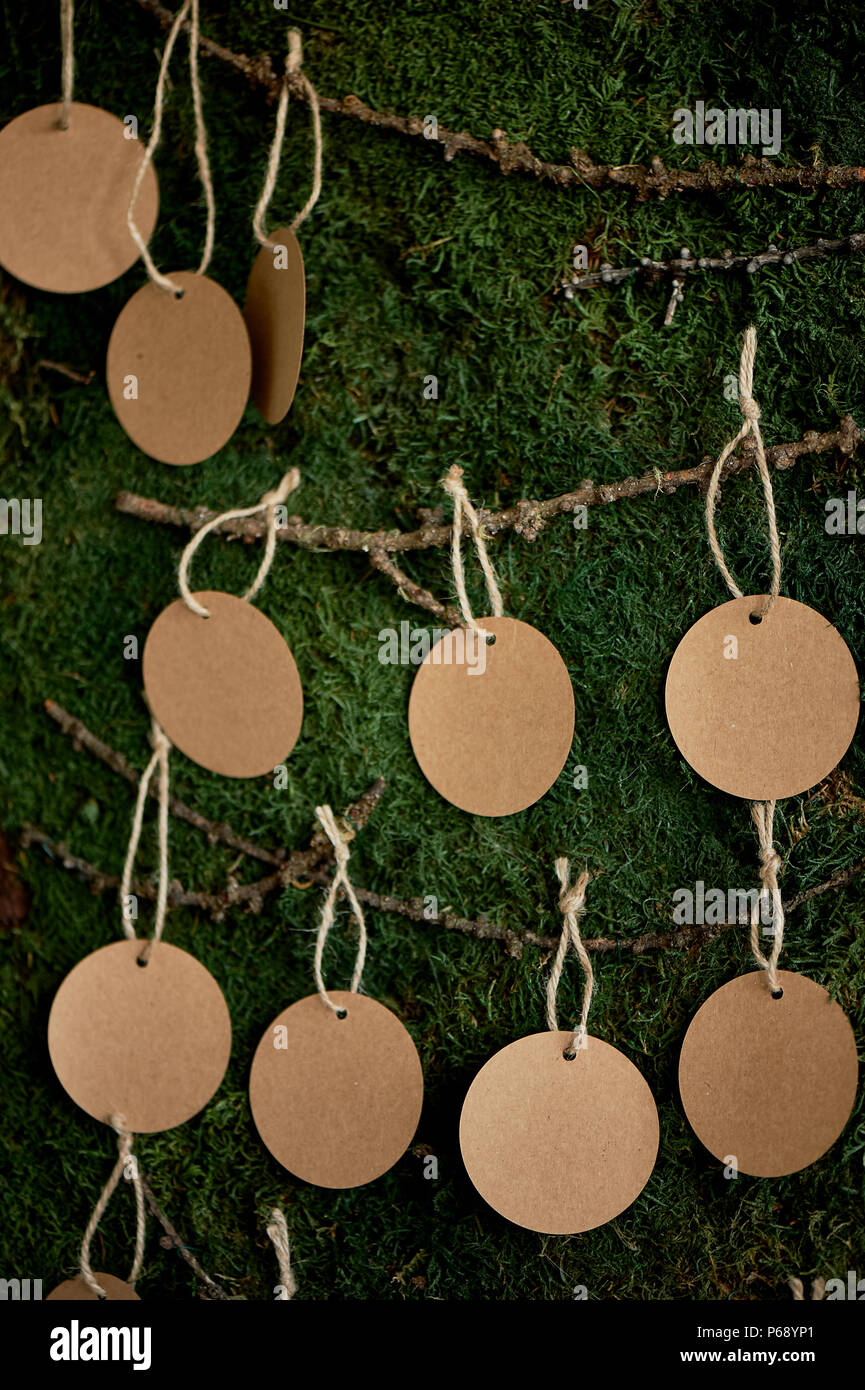 Seating plan, wedding decor in rustic style.Moss, bark, wood, crafting cards. - Stock Image