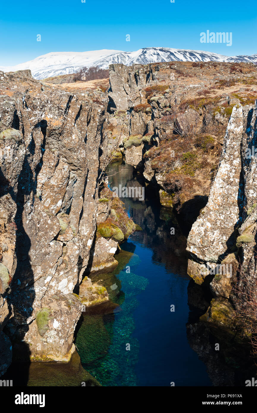 craggy rock formation forms a canyon in thingevllir national park, shot during daytime in good weather conditions, iceland april 2018 - Stock Image