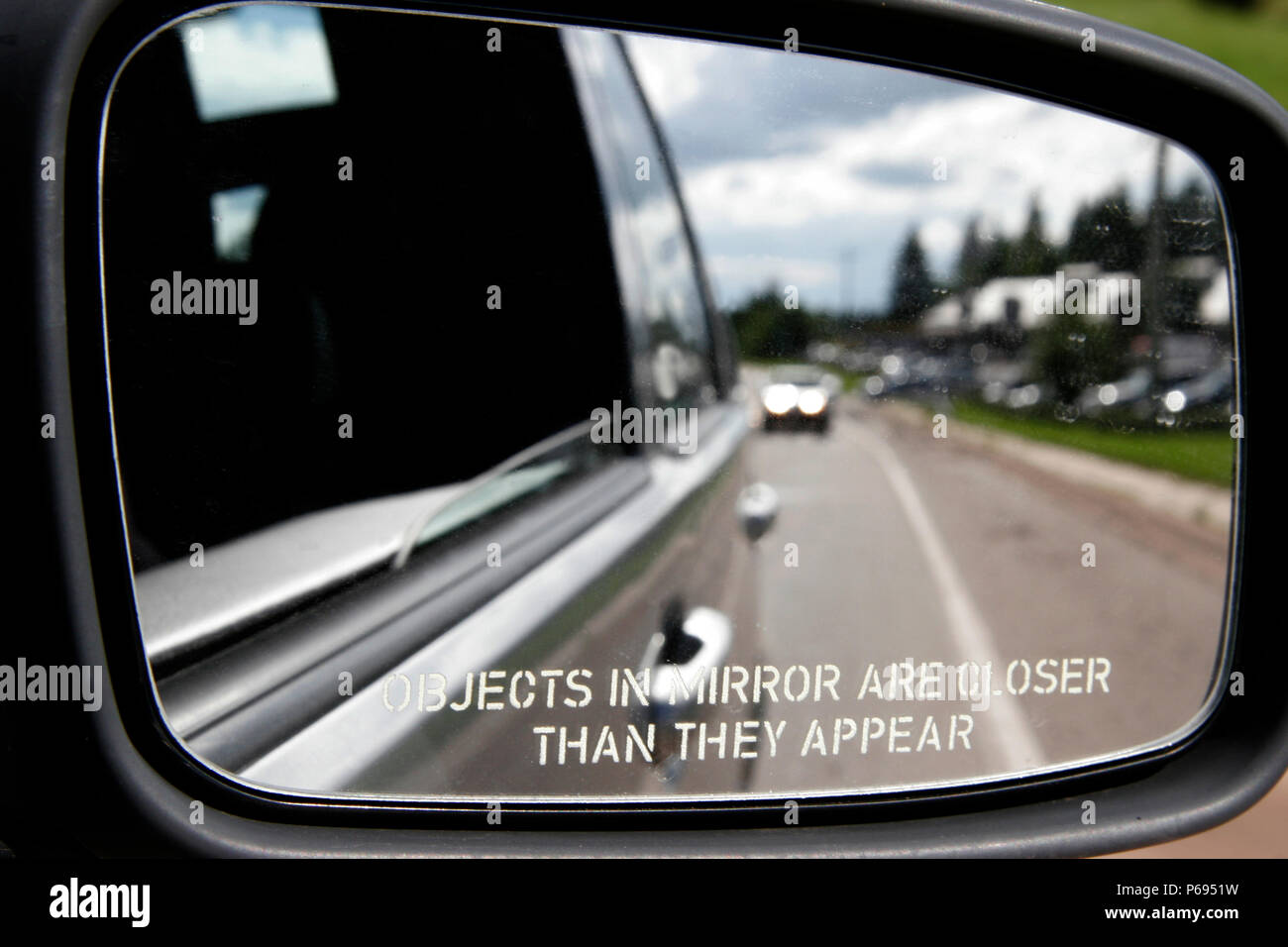 Objects In Mirror May Be Closer Than >> A Mirror On The Side Of A Car States A Warning Objects In Mirror