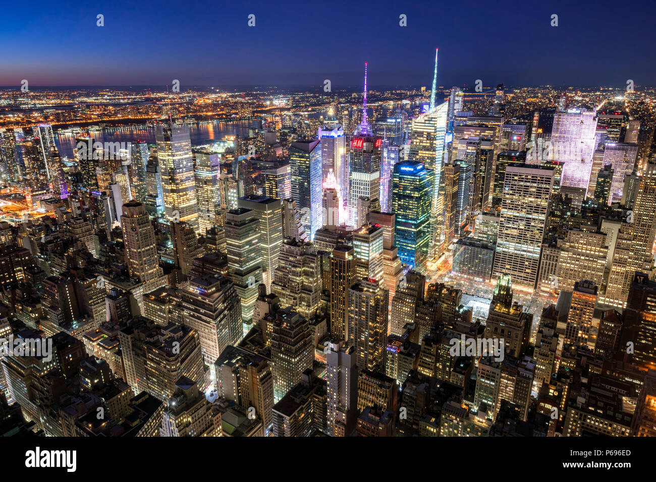 New York City, NY, USA - Mach 11, 2018: Midtown Manhattan skyscrapers illuminated at night (Times Square) - Stock Image